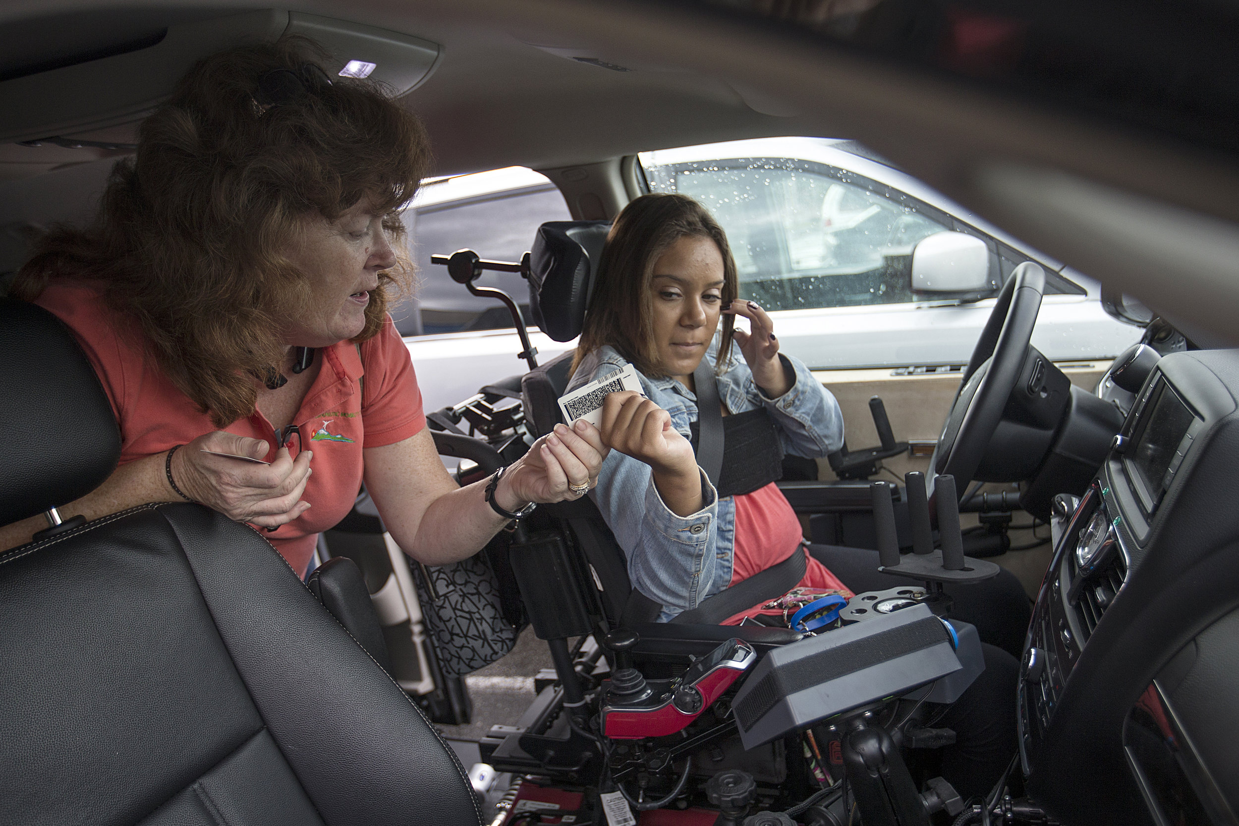 Eva Richardville, an instructor from Therapeutic Mobility Services, prepares Macy Huff for her driving test at the Brownsburg Bureau of Motor Vehicles, Sept. 28, 2016. Huff passed her test, and will have a Ford Explorer adapted for accessibility in the coming months. After learning about her journey earlier this year, an anonymous donor offered to purchase an adapted vehicle for Huff.