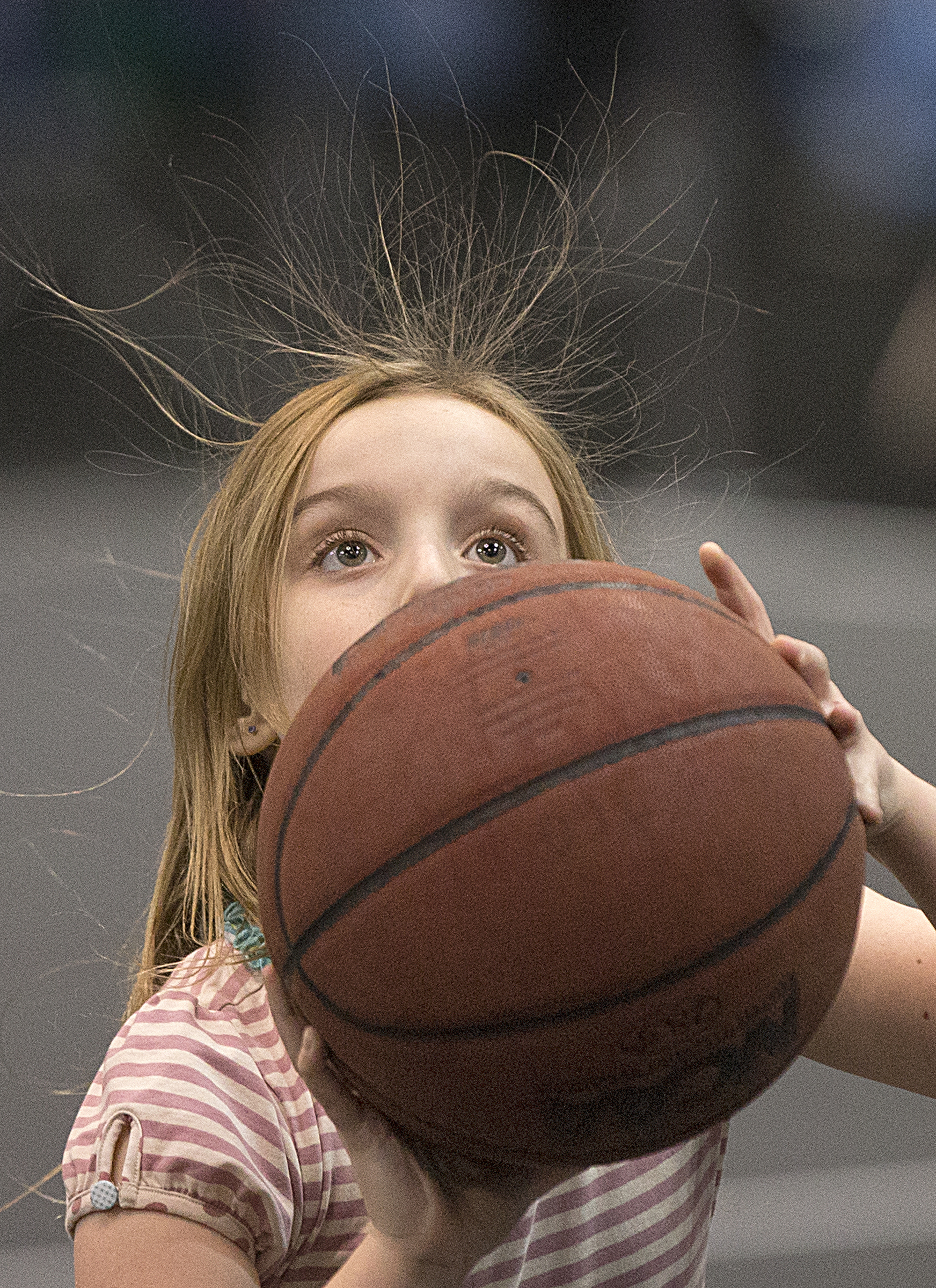 Hannah McCoy, 8, has a case of wintertime-static as she lines up a free throw at the Big Ten Fan Fest, held at the Indiana Convention Center, downtown Indianapolis, Friday, Dec. 2, 2016.