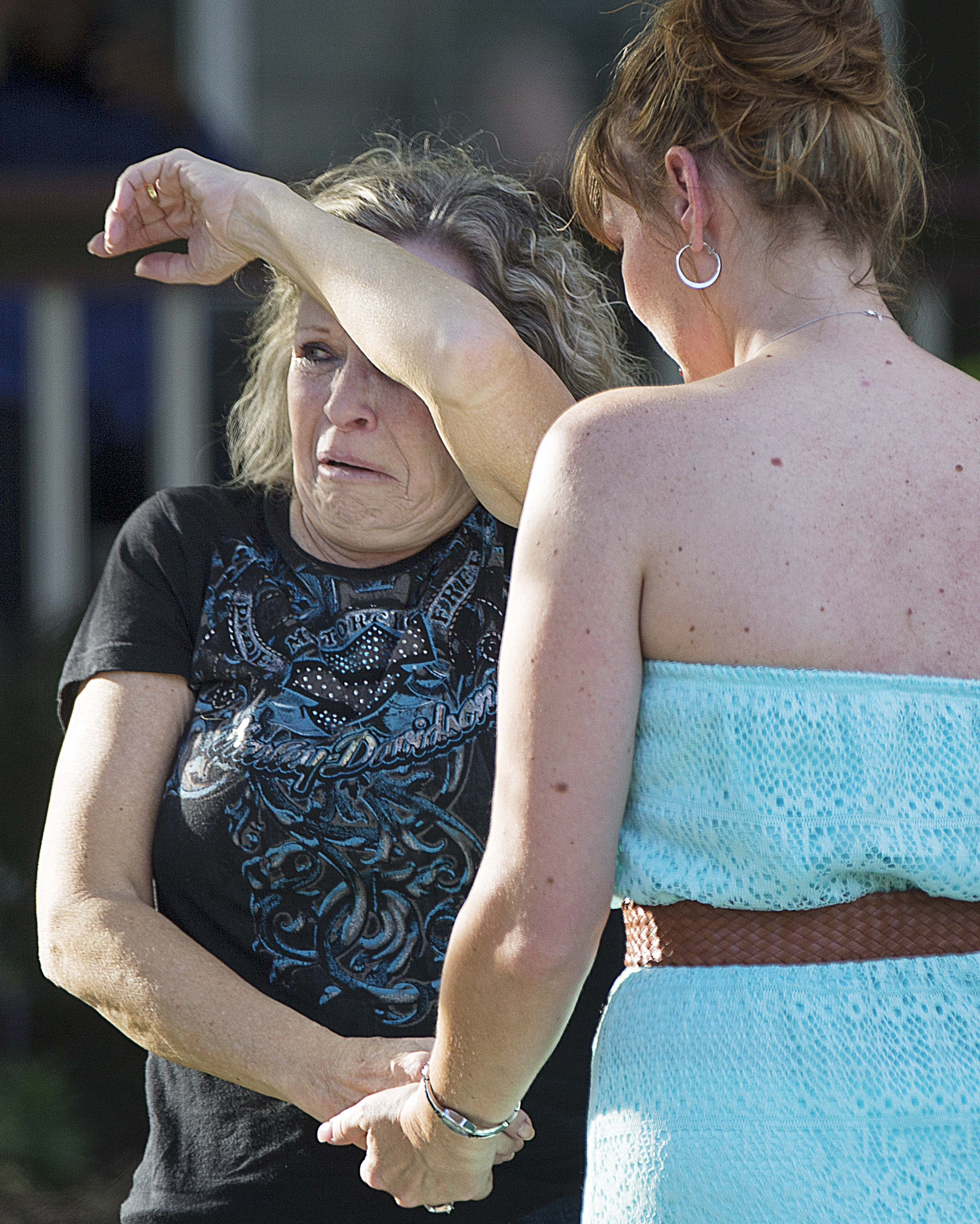 A mother reacts to her daughter's death at the scene of a double homicide at a residence on Soaring Eagle Court, west side of Indianapolis, Thursday, September 22, 2016.