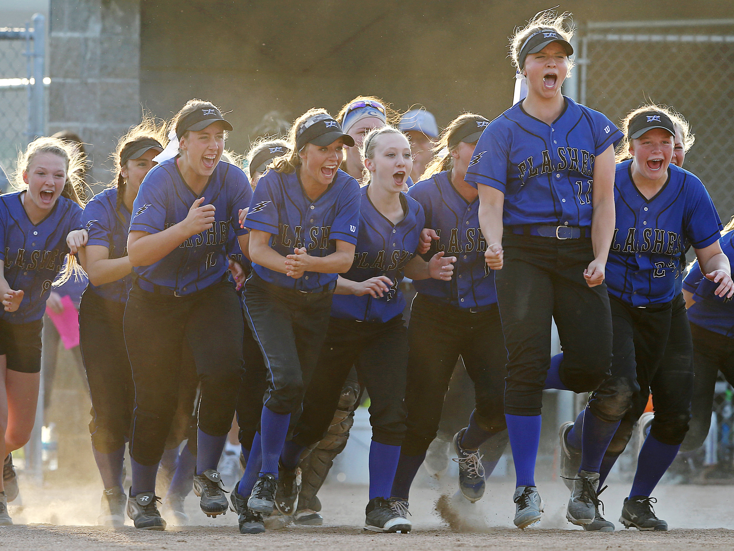 The Franklin Central Flashes celebrate an 8-0 defeat over Center Grove in the sectional final, at Franklin Central, Indianapolis, Wednesday, May 25, 2016.