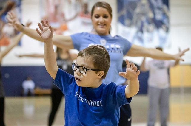 Will Meehan, 6, of Fishers, learns a dance routine before the Butler women's basketball game at Hinkle Fieldhouse on Sunday. Butler cheer and dance groups paired up with Indiana University physical therapy students to teach young people with special needs the routine in preparation for a performance that took place during halftime of the women's game. (Follow the photographer  @bobscheer)