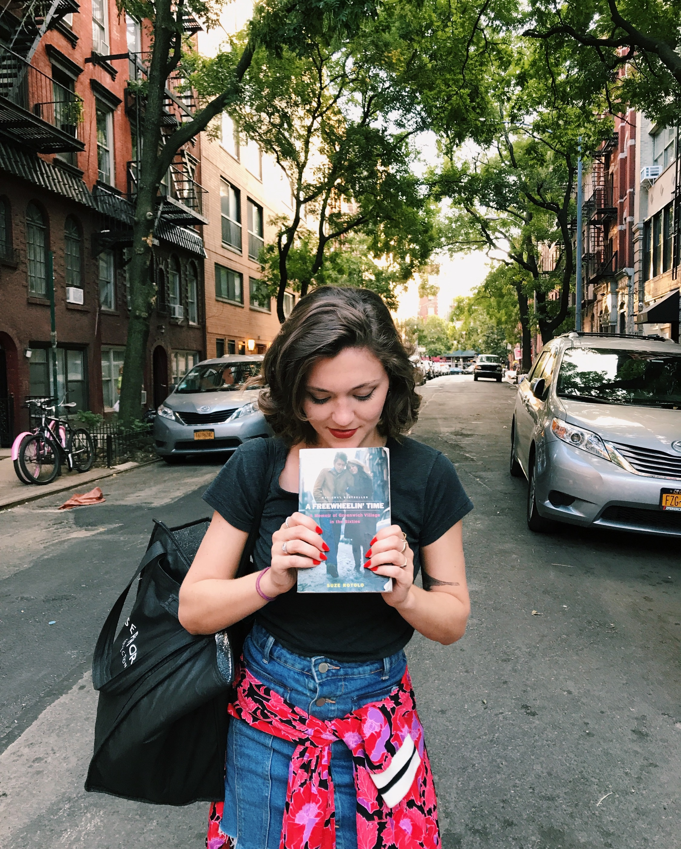When you stumble upon the Freewheelin' street with book in hand, you take the cheesy picture.