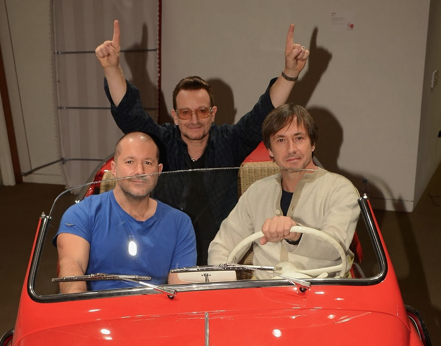Apple SVP of design Jony Ive and Apple industrial designer Marc Newson with U2's Bono.Photograph courtesy (RED) .