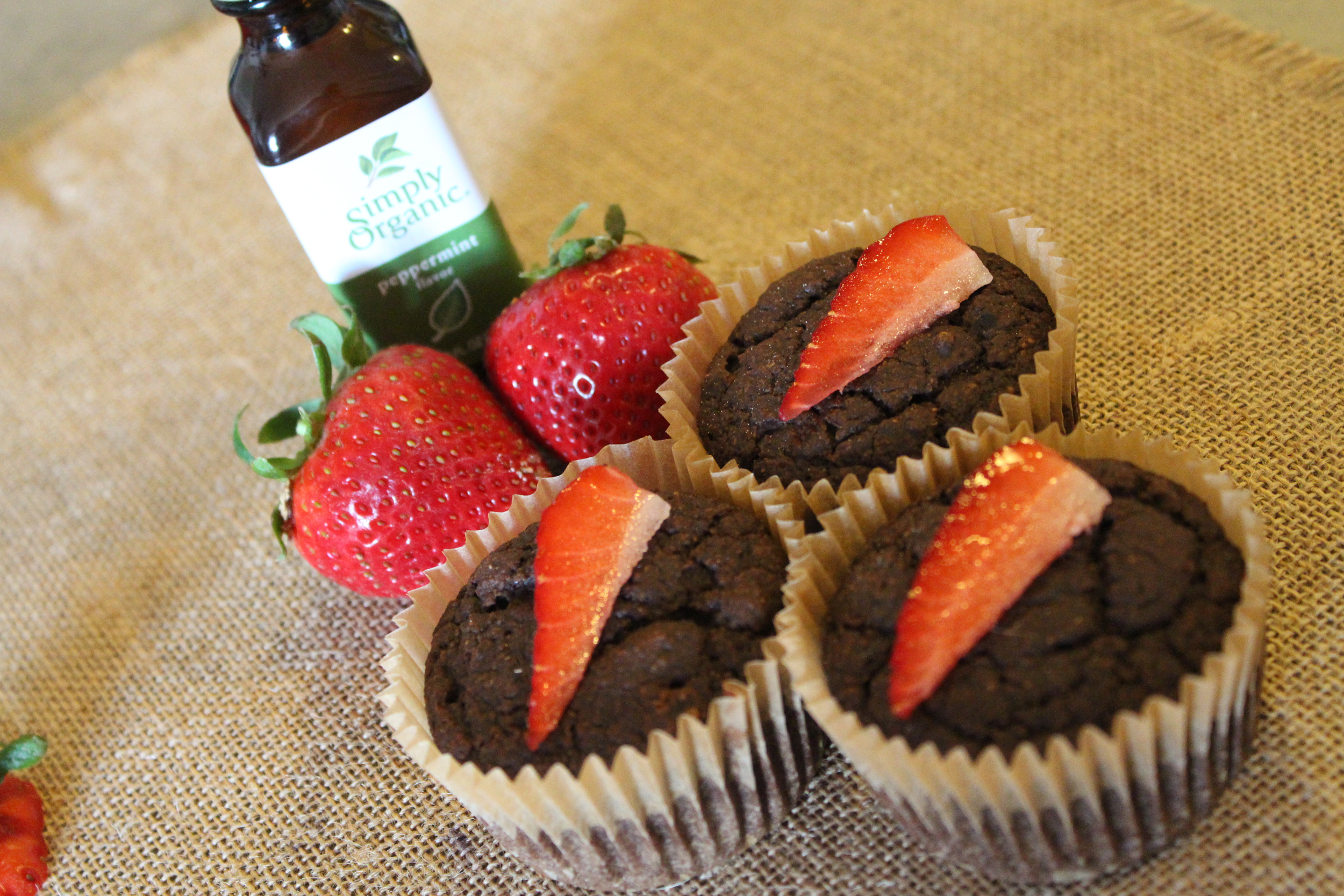 We made cupcakes, too, that are even better for sharing. No icing, no problem. We topped with strawberry quarters and 2 drops of organic peppermint oil.