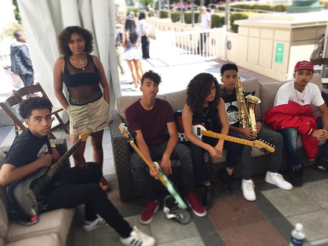Catching some shade in Downtown Oakland waiting to perform for the Back to School Rally #music #backtoschool #education #bass #drums #guitar #piano #singing #thejammingnachos