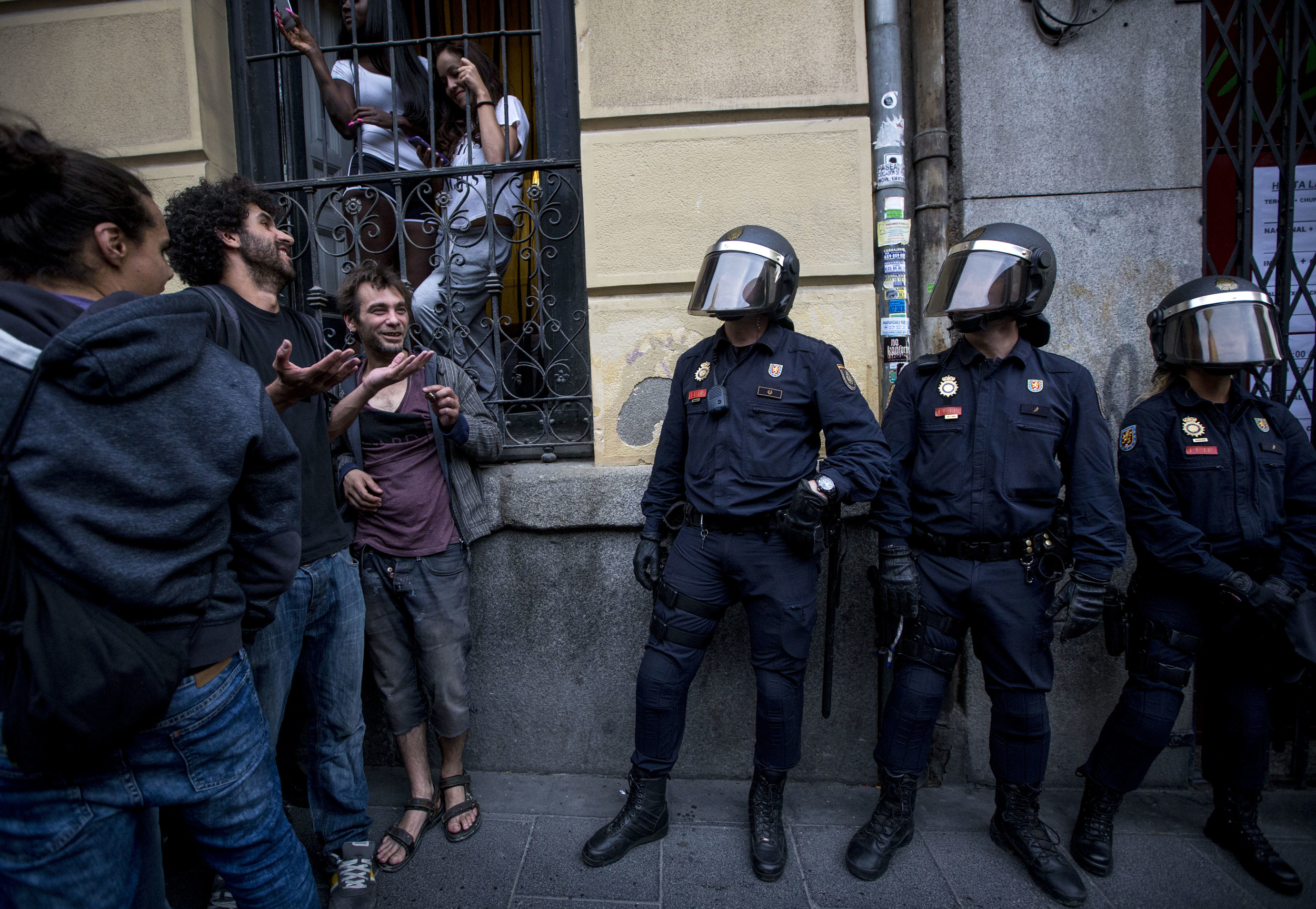 "Protesters and police confront near the new Patio Maravillas, an occupied space used by community members and activist groups on June 11, 2015 in Madrid, Spain. The new ""okupa"" is a result of the eviction and permanent closure of the previous space."