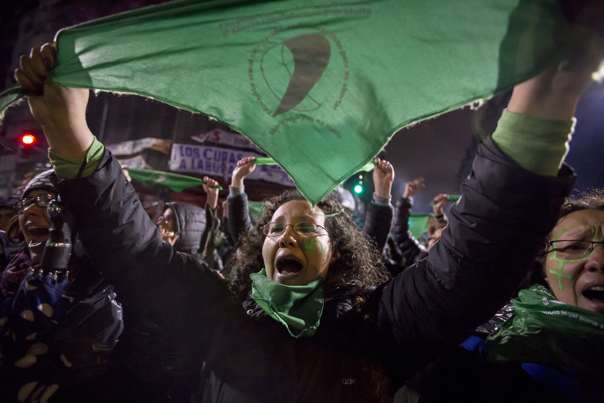 A woman protests with the green handkerchief – the symbol of the pro-choice movement – during the vigil of the bill which would de-criminalize and legalize abortion near the Congress in Buenos Aires, Argentina, on Aug. 8, 2018.