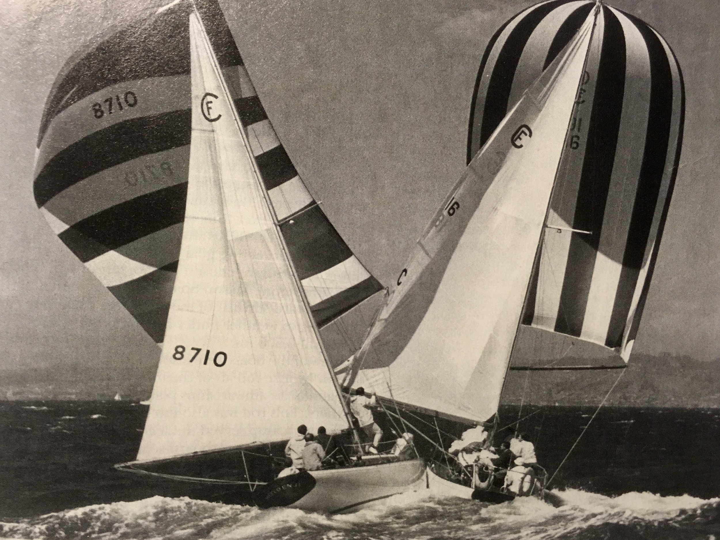 HOYDEN II (8710) and CIRCE (16) all tangled up. Note the masthead spinnakers, compared with the fractional rig. Once declared a development class in the mid-1950s, the Clippers were open to aggressive innovations in the search for speed. in 1964, CIRCE became the first to adopt the masthead rig, but others quickly followed suit.
