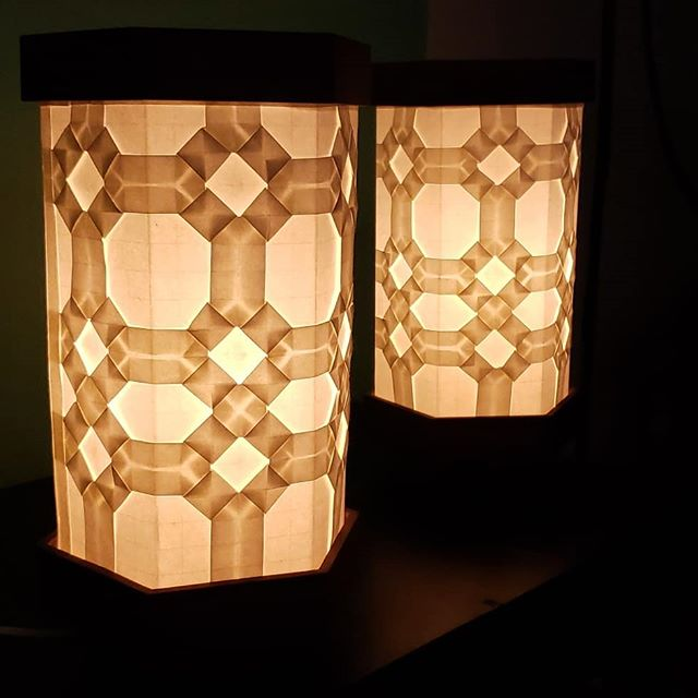 Been working on myself, but also trying to level my woodworking.  This pair of lamps is the first of my B-Type lamps.  The shade, base, and top are secured with magnets, making it easy to disassemble and reassemble for moving and maintenance. I designed the origami portion to have a leaded-glass look, focused on octagons and squares to give the sense of facets. Wood is walnut.  Pretty happy with the overall look, feels good to be back to making things. (Currently available, $500 + s/h for pair) #origami #design #woodworking #lighting #tessellation #couldadepressedpersonmakethis