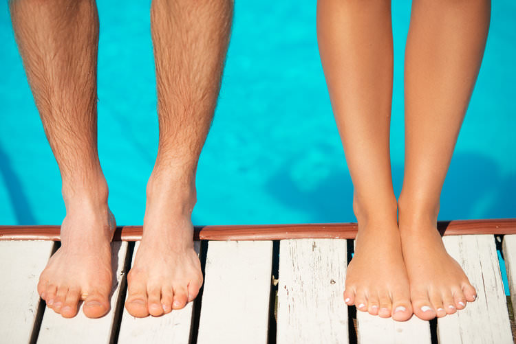 couple standing on the edge of a pool.jpg