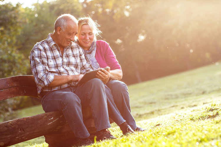 couple looking at pictures in the park.jpg