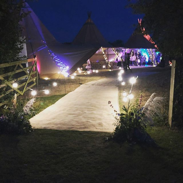 Photo does not do this beauty justice. The coloured uplighters worked beautifully @hire_frequencies @timberandcanvas #kentweddingplanner #weddingathome #tipiweddings #fieldwedding