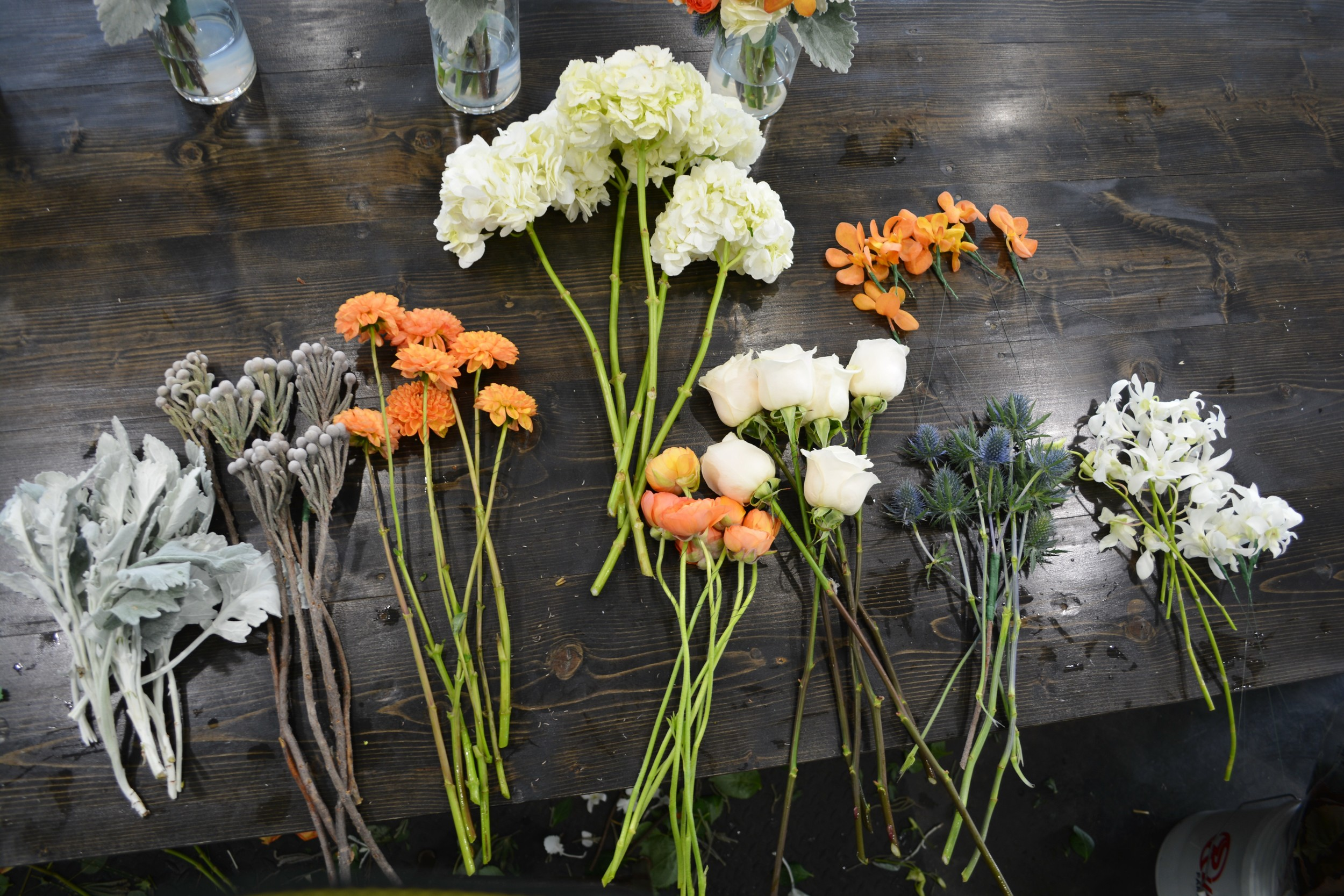 This is basically how I start a bouquet:  Count out each flower I will be using  Wire the more delicate flowers...lay them out in piles and start to create!