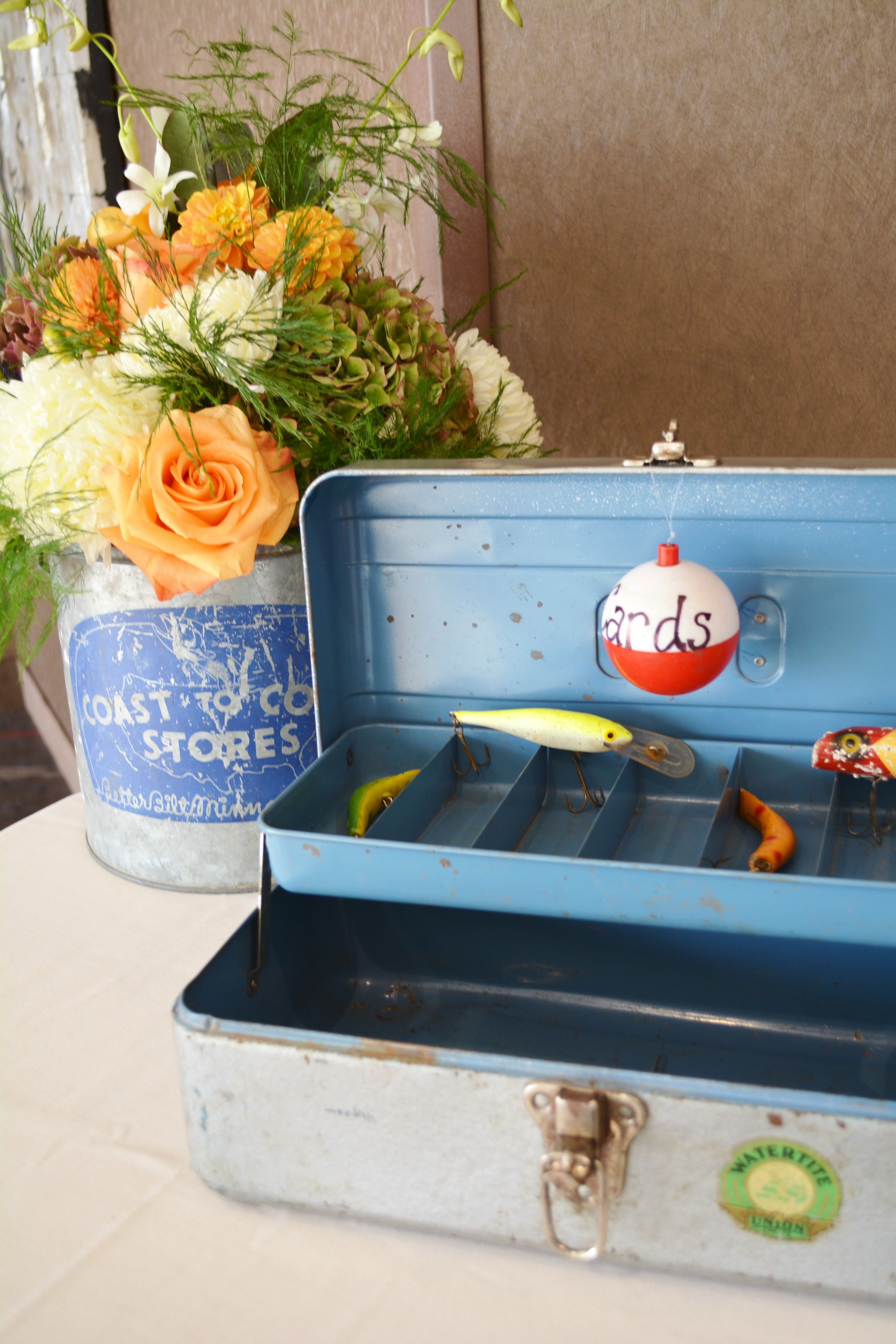 This was so fun...I designed an arrangement inside this antique minnow bucket which sat next to Karen's (Megan's mom) grandfathers tackle box used for cards. The lures inside were the groom's grandfathers.