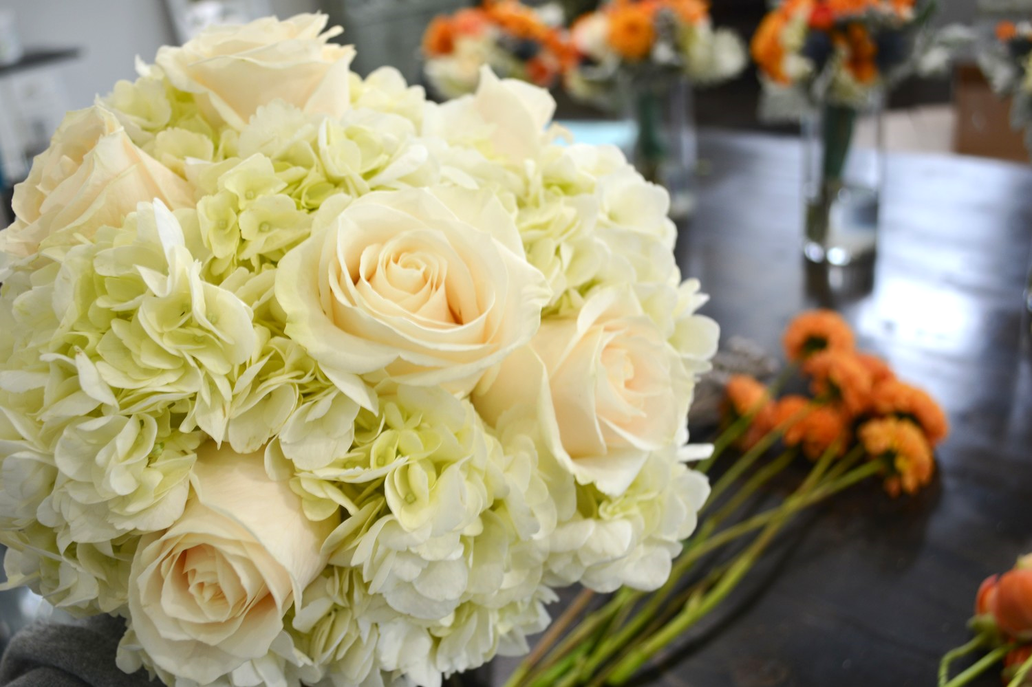 For Megan's bouquet...I started with the white hydrangeas and lovely cream roses