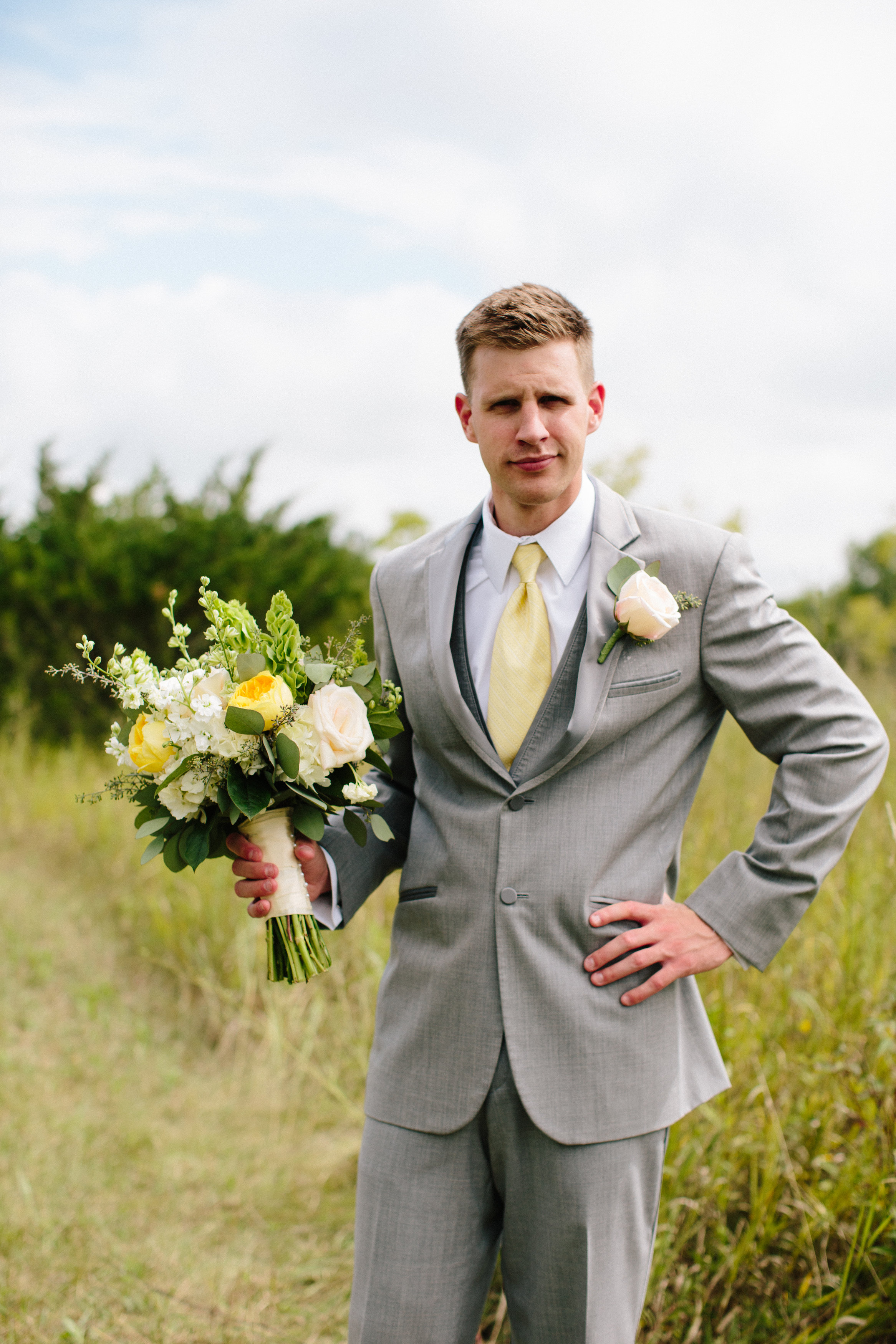 Notice Shean's confidence.....He's not ashamed to pose for this shot holding his brides lovely bouquet