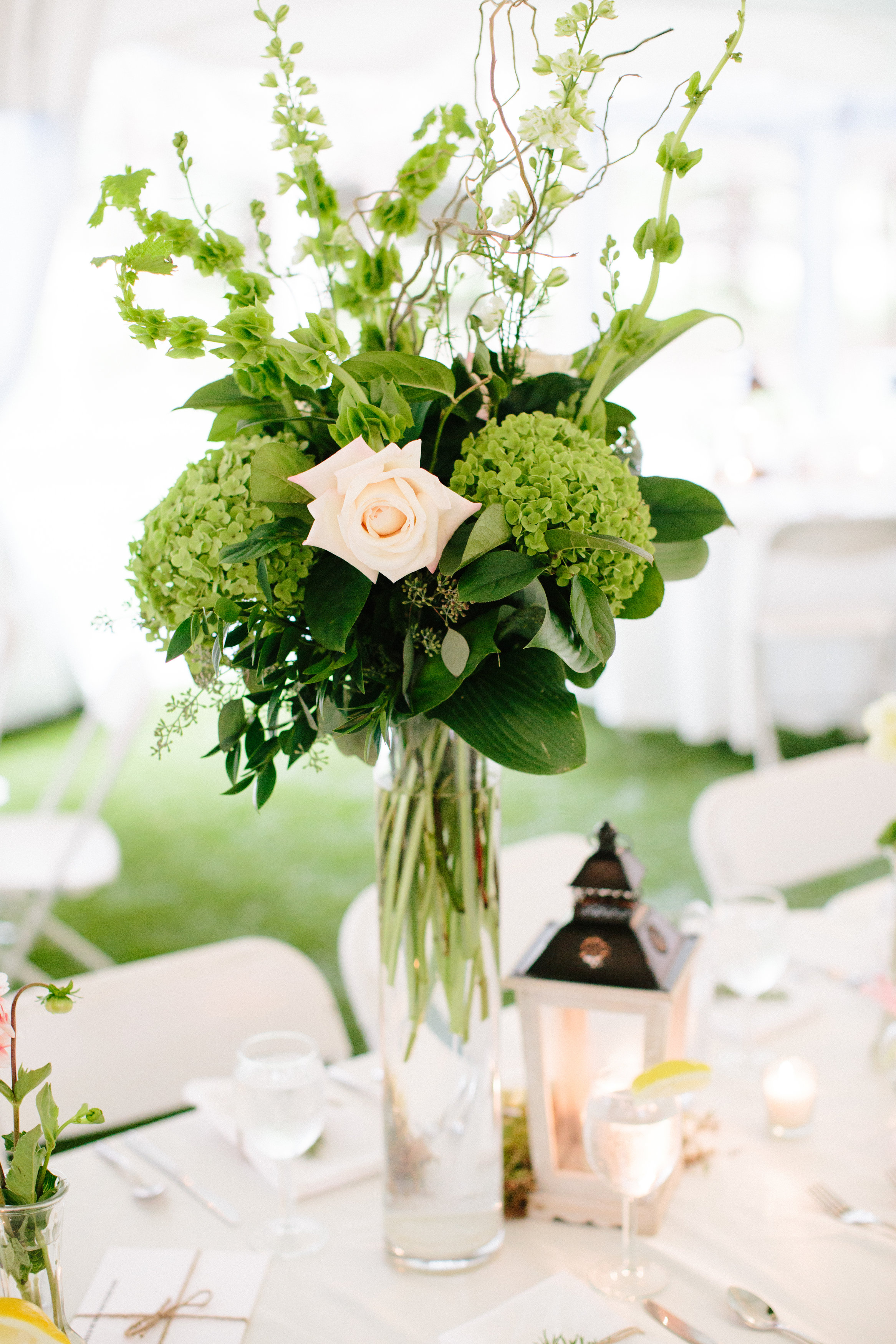 One of my favorite centerpieces....different varieties of foliage (most harvested from people's landscaping) with small splashes of color mixed in.