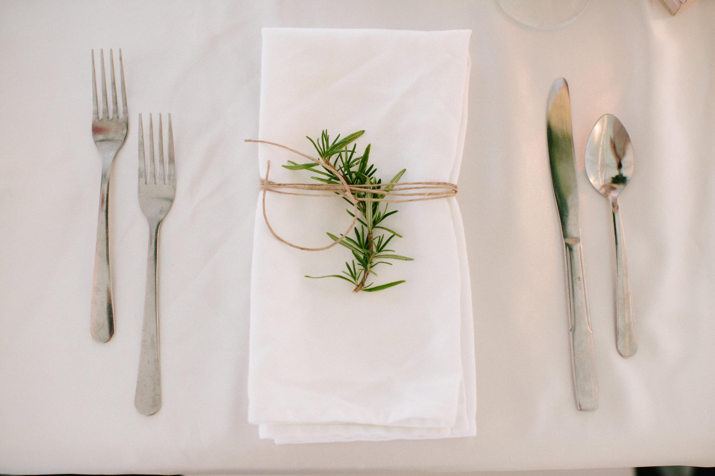 A sprig on every napkin....simplistic beauty