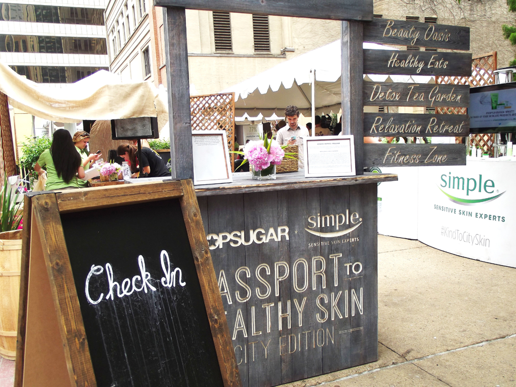 """Iwalked down Main St. to find this cute little check-in station for the event where I received my""""passport""""."""
