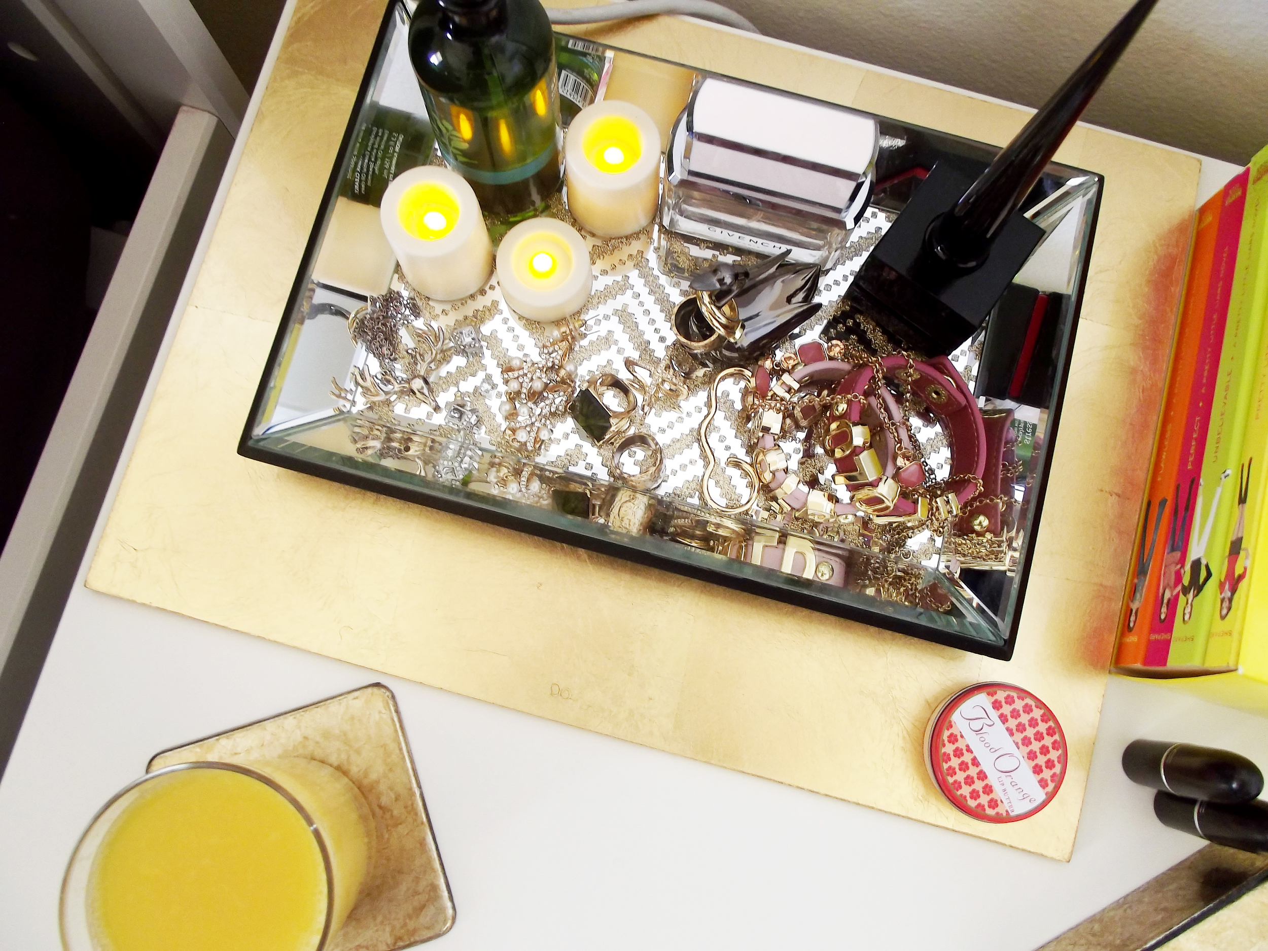 Before I added this chevron tray to the mix, my jewelry was just lying across the hatch of my desk which was probably the worst place for it. I found this mirrored chevron tray ($14.99 regular discounted price) and had to get it! I also added a few flameless candles ($6.00, yellow-tag) and placed the tray on this gold fiberboard placemat ($2.00, yellow-tag).
