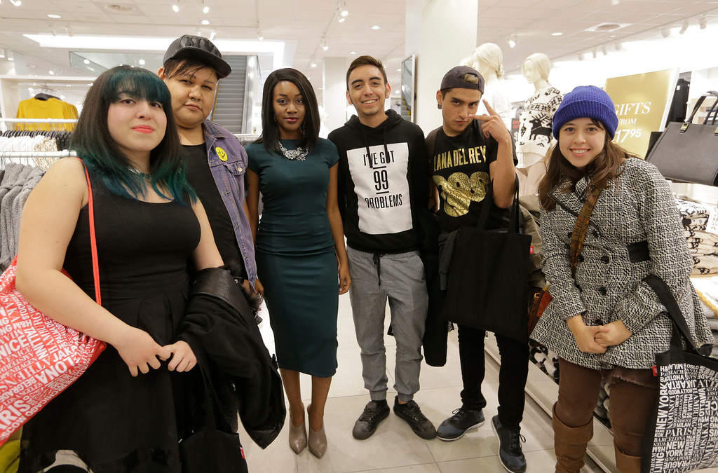 Jaleesa Charisse (formerly The Fashion Geek)with Twitter winners at the H&M opening event at Cielo Vista mall in El Paso, Texas on December 18, 2014.