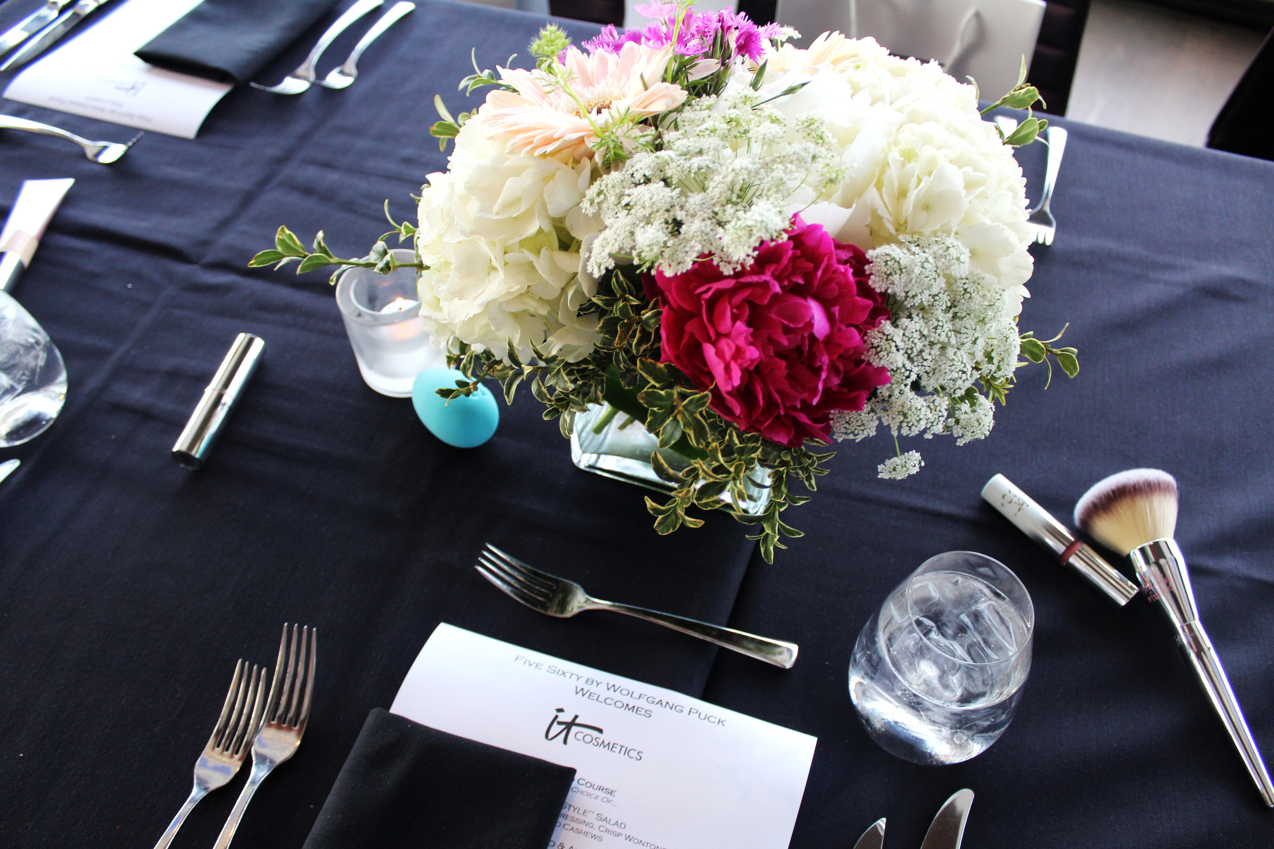 Loved the IT Cosmetics as table décor!