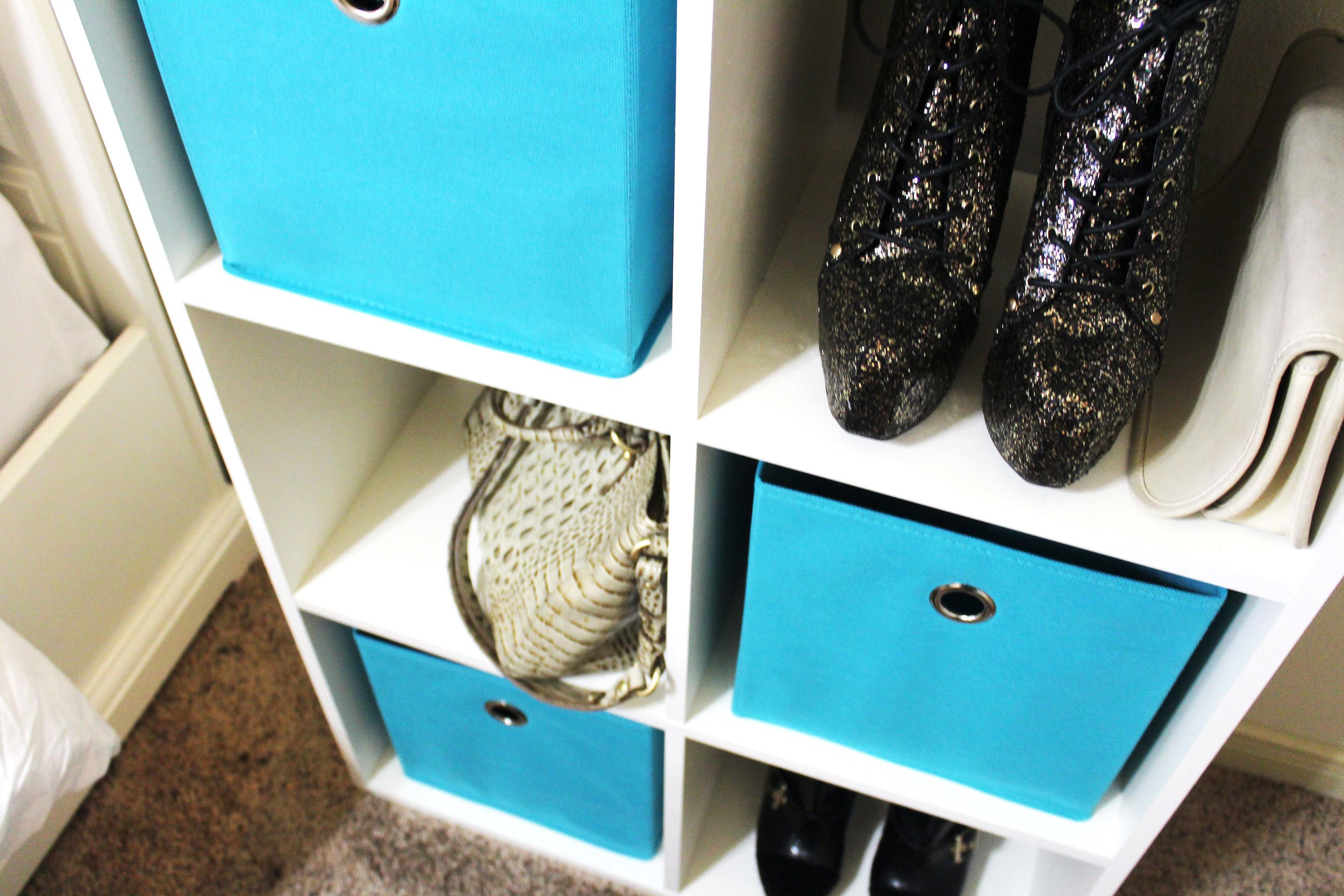 These teal fabric storage bins add a pop of color to my shelf and keep it much more organized. It's a great way to appear tidy if you're really not! |  Room Essentials Fabric Storage Bins  ($6.99 ea.)