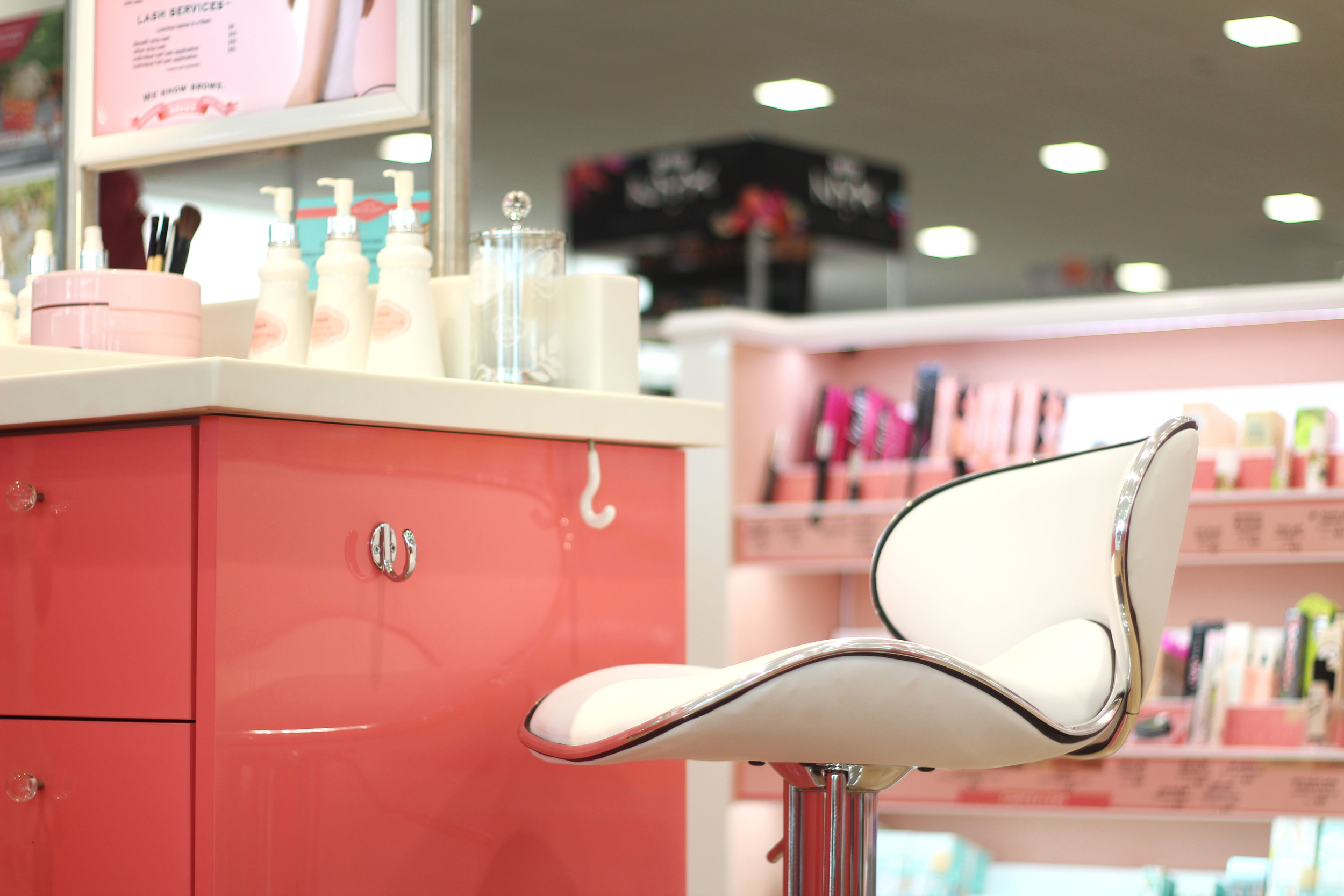 Sit down and relax at a Benefit service station while the pros beautify you.