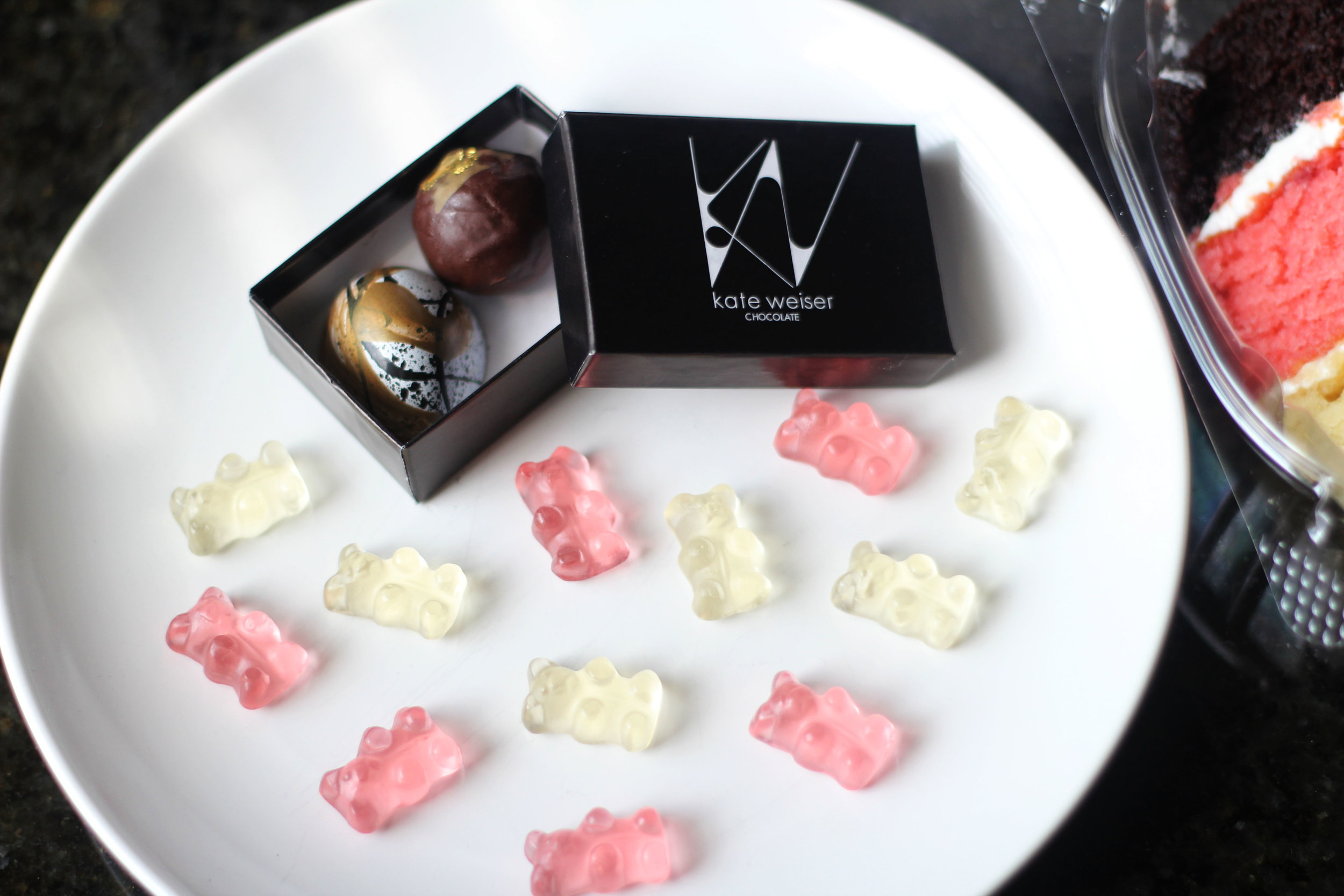 Kate Weiser chocolate from Trinity Groves and Baby Champagne Bears infused with Dom Pérignon Vintage Champagne (Brut & Rosé) from Sugarfina at Market in Highland Park Village.