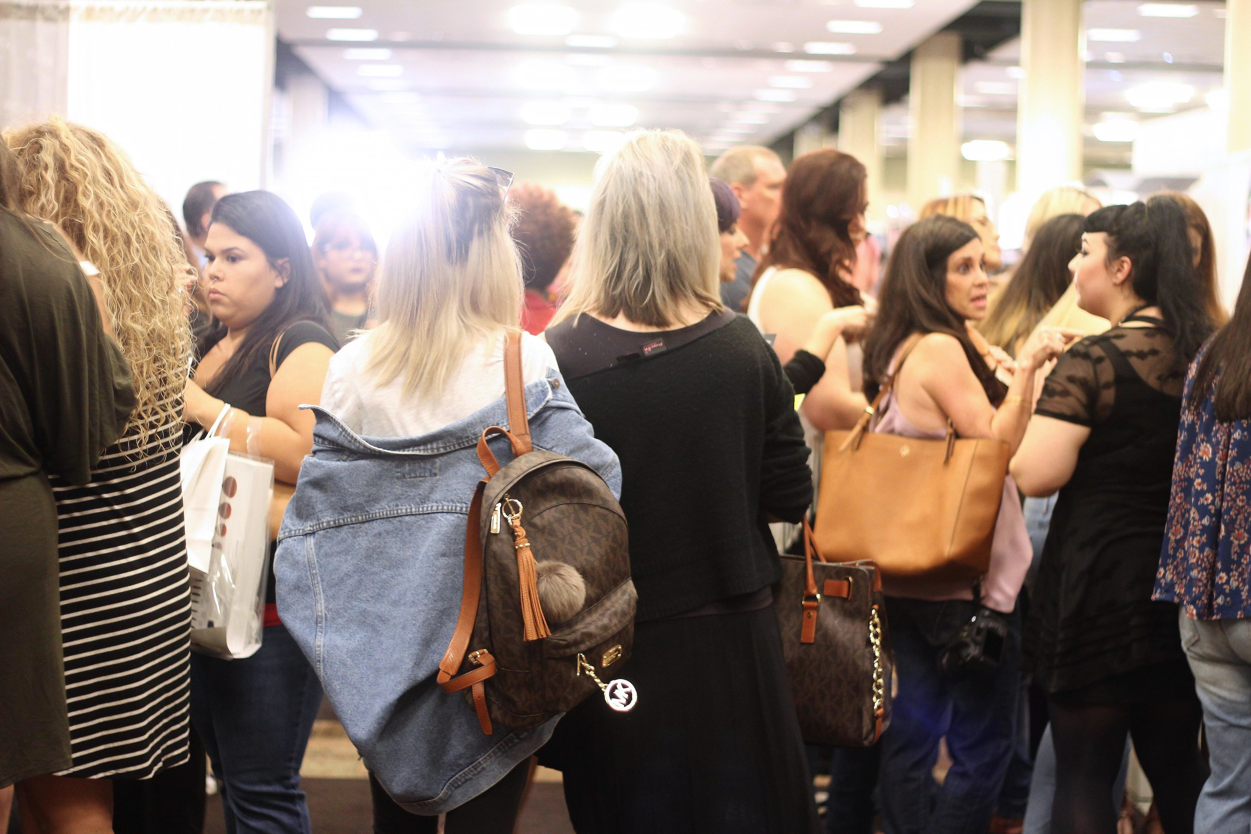 people walking at the makeup show dallas