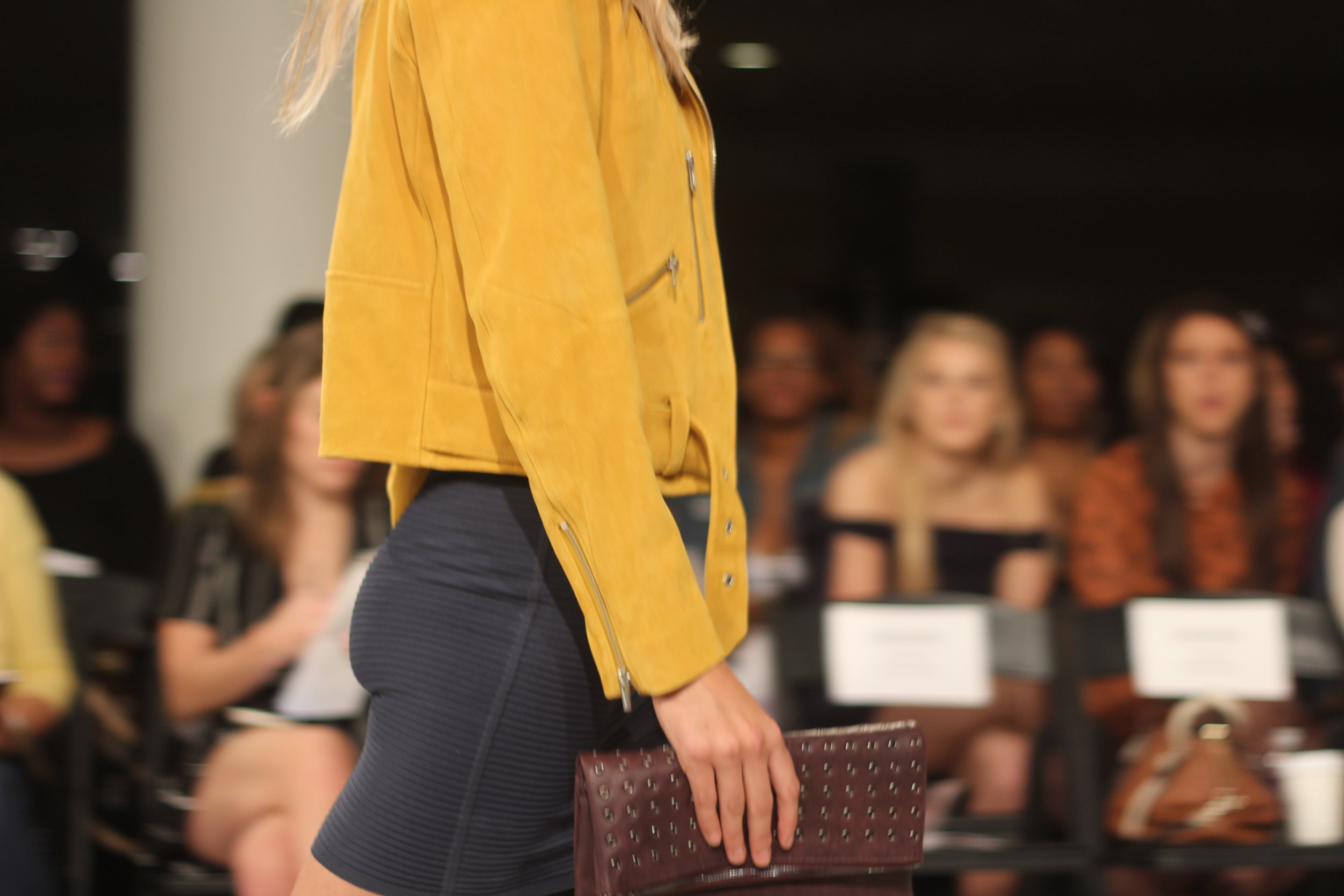 A pop of mustard in a suede moto jacket at the Nordstrom Beauty Trend Show.