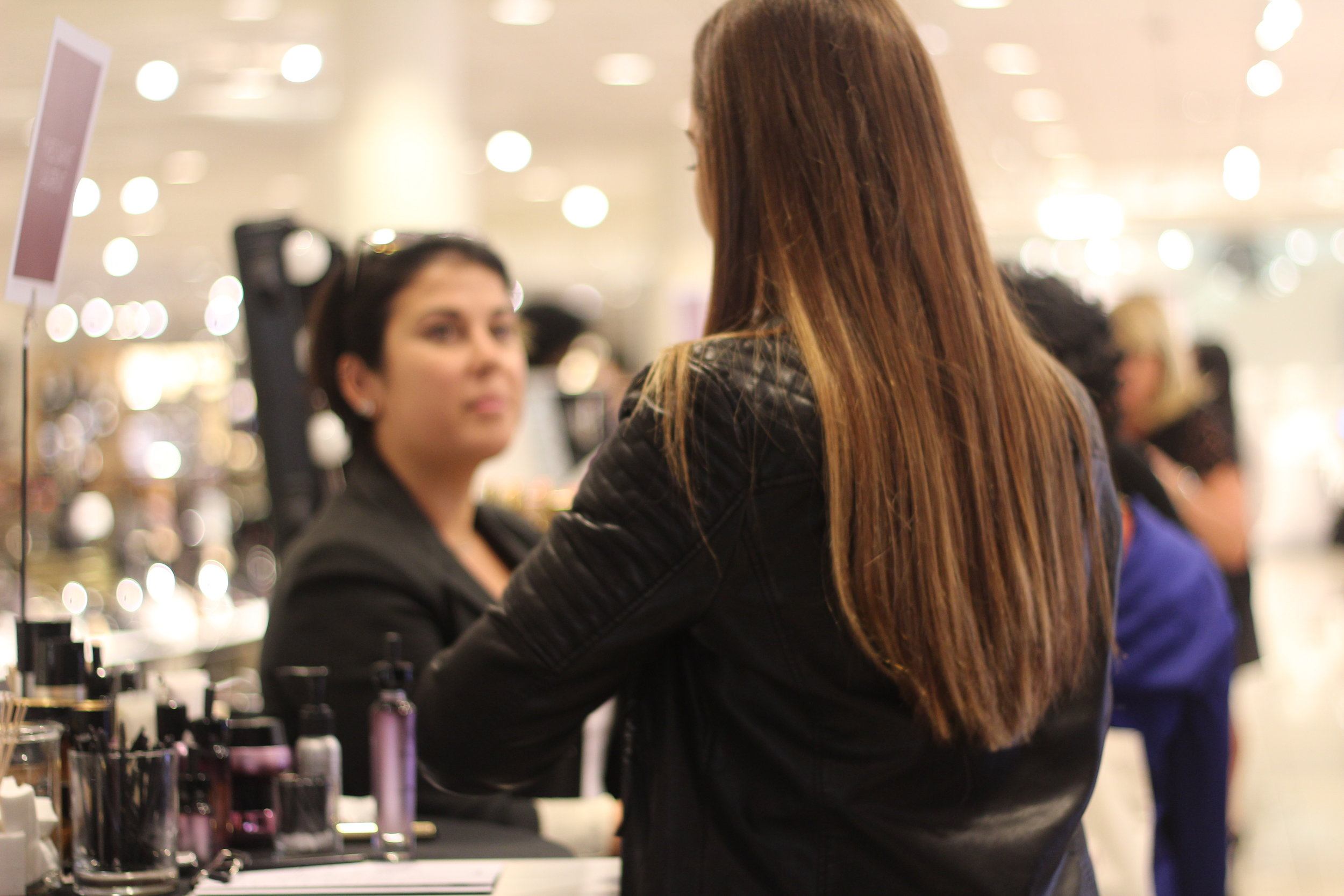 Customers getting beauty consultations after the Nordstrom Beauty Trend Show in the beauty department.