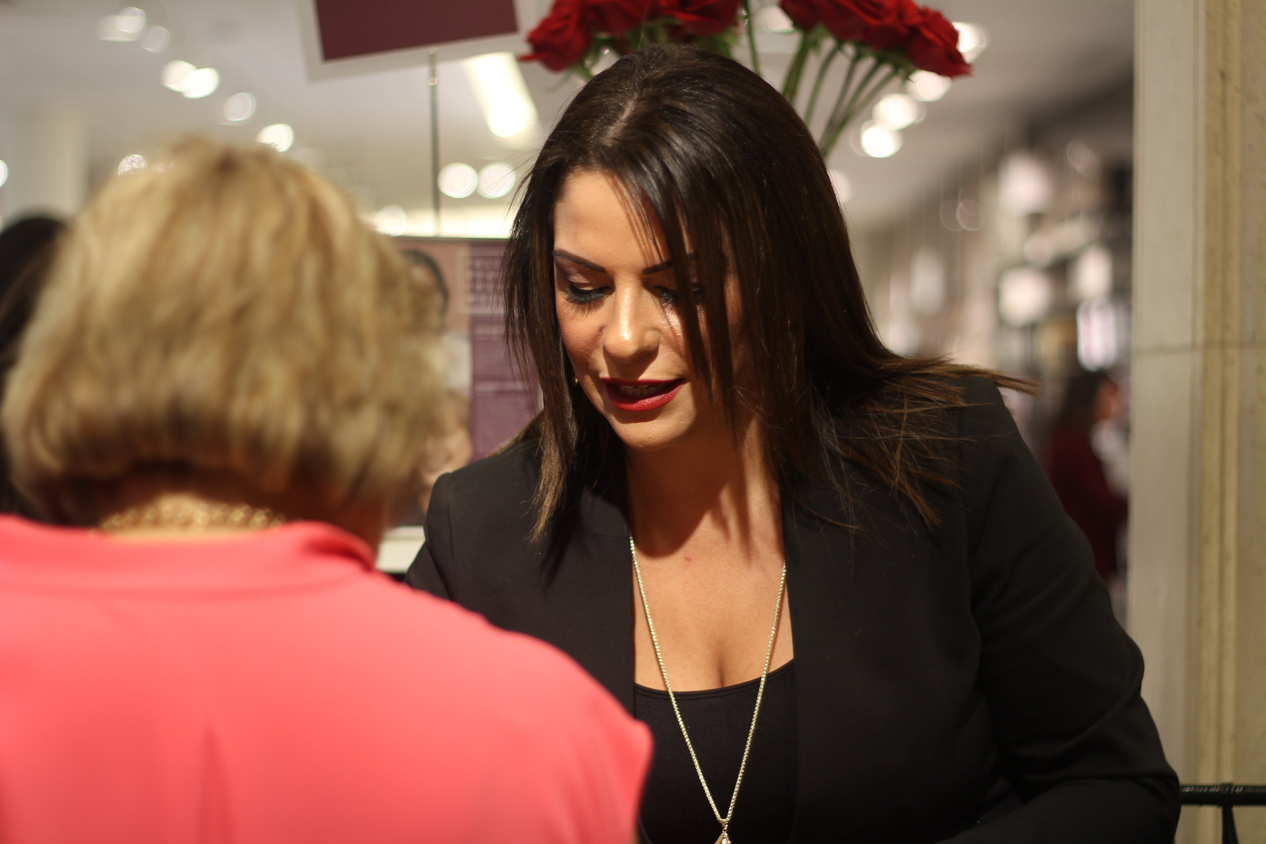 Karen from Parfums de Marly speaking with customers about the 18th century-inspired fragrances.