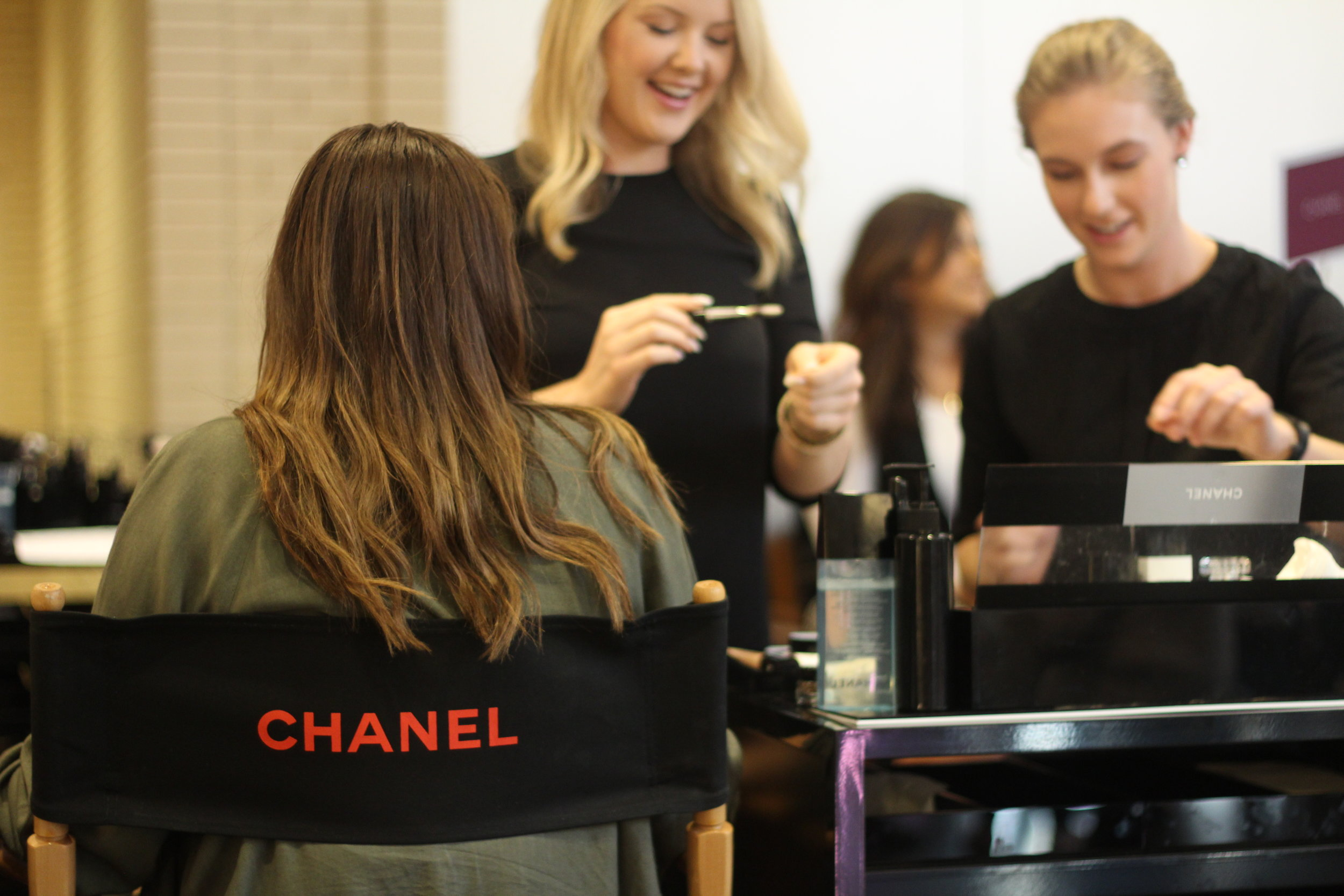 Customer getting a quick makeover at Chanel after the Nordstrom Beauty Trend Show at NorthPark Center.