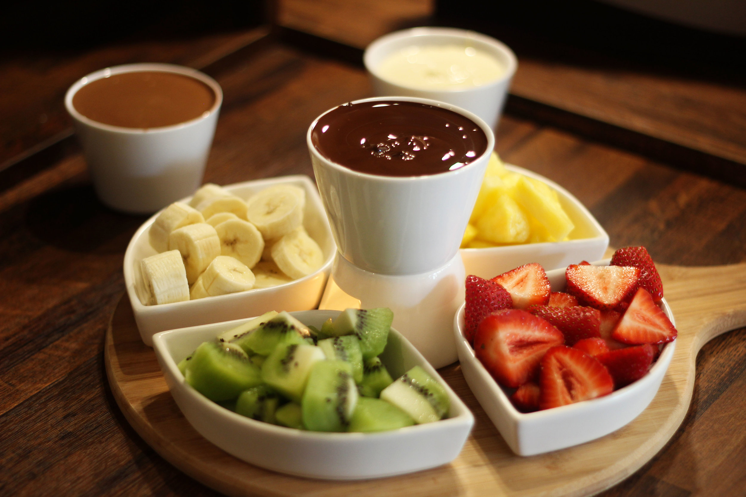 Chocolate Fondue    This delicious fondue is every girl's dream with sweet strawberries, bananas, kiwi, and pineapples to dip.