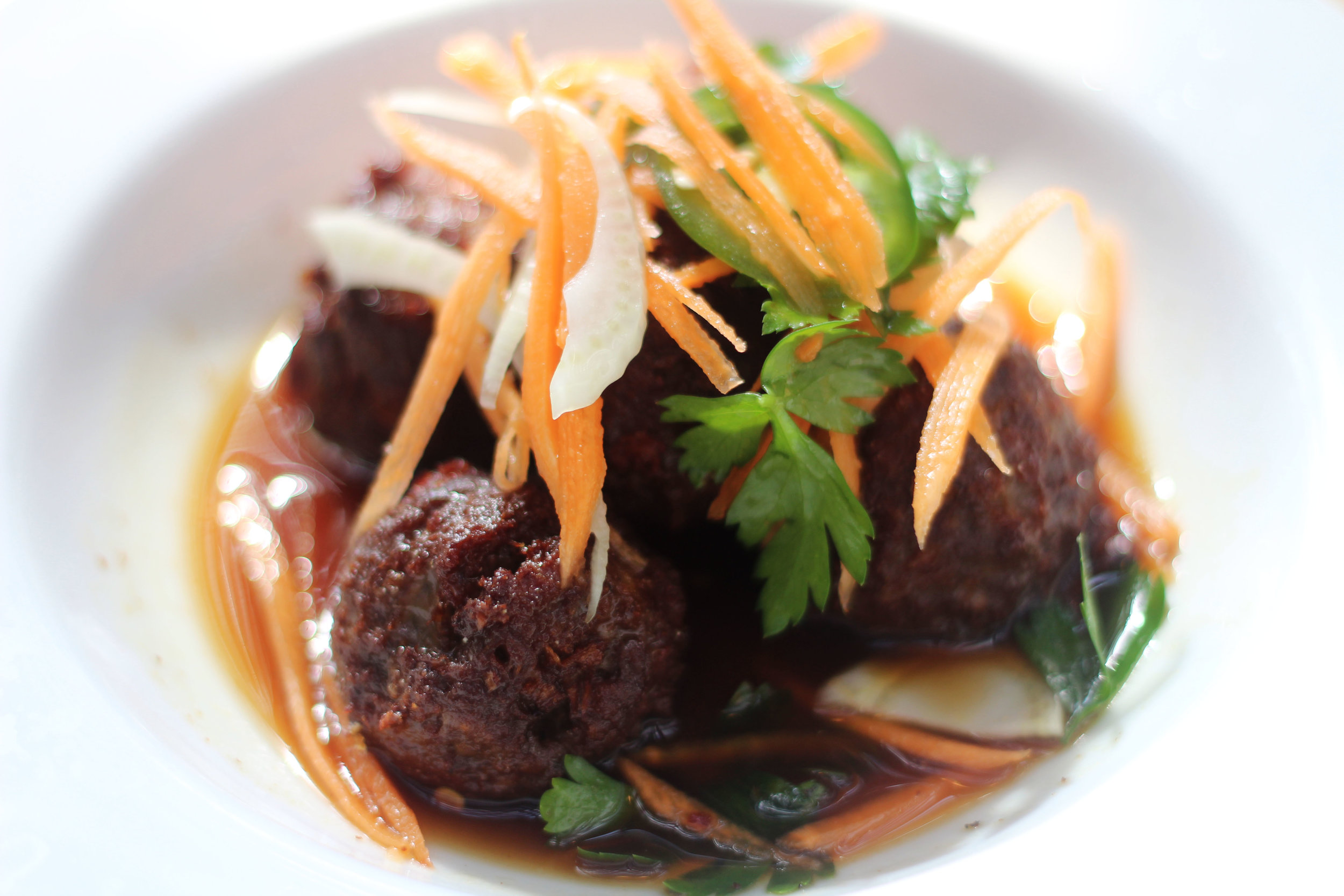 Maple Bourbon Meatballs |  Akaushi beef topped with fennel slaw