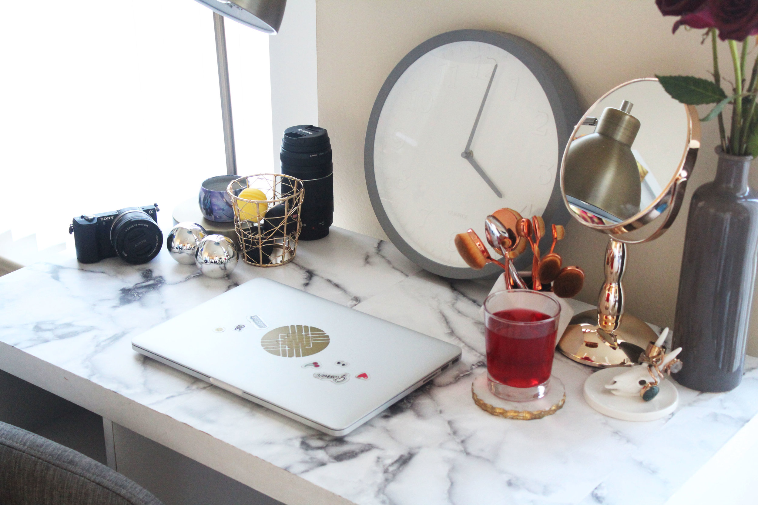 Rose gold table mirror ($14.99) // Clock ($14.99)