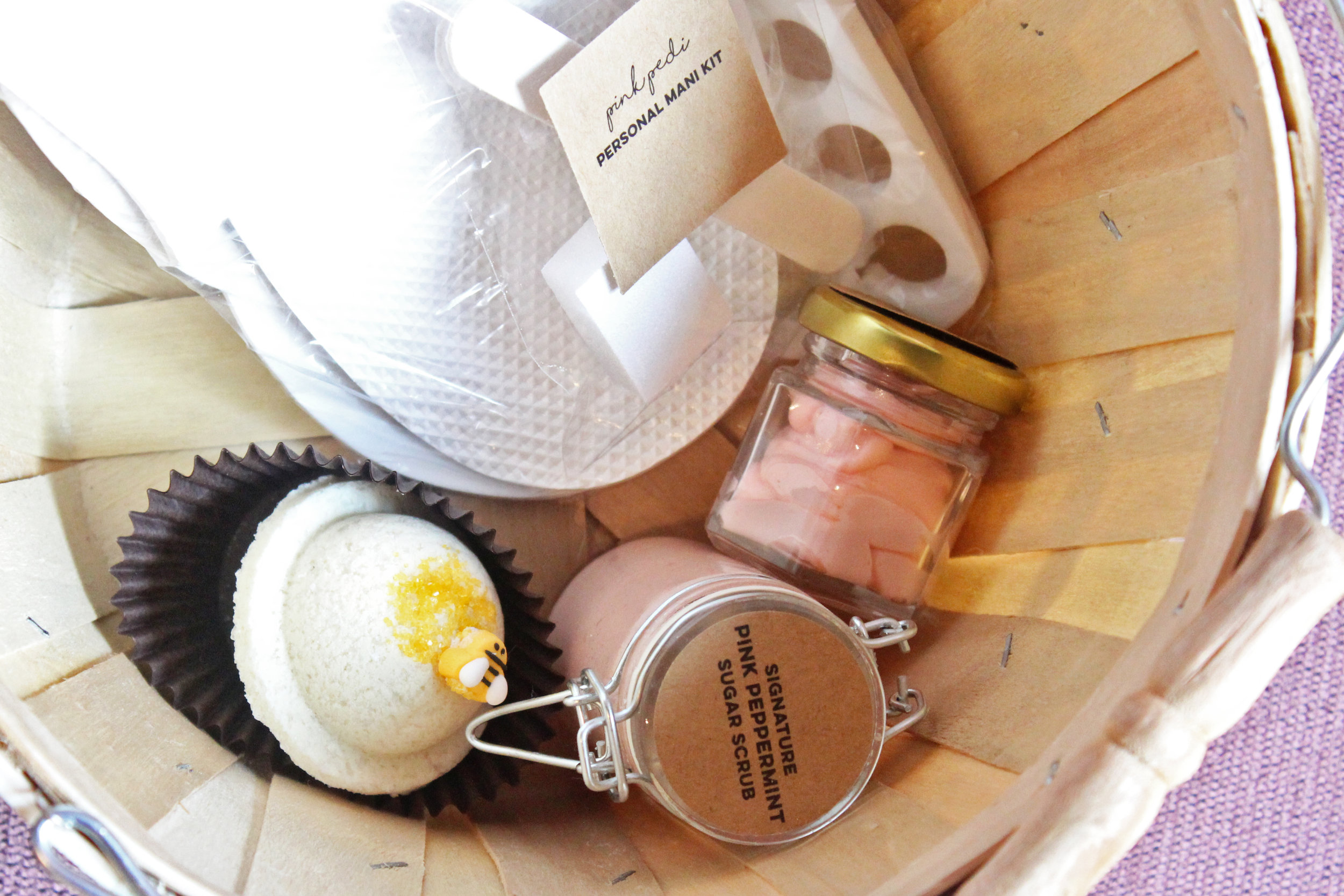My customized basket at Pink Pedi with clean pedicure tools and my choice of a bath bomb, sugar scrub, and body butter.