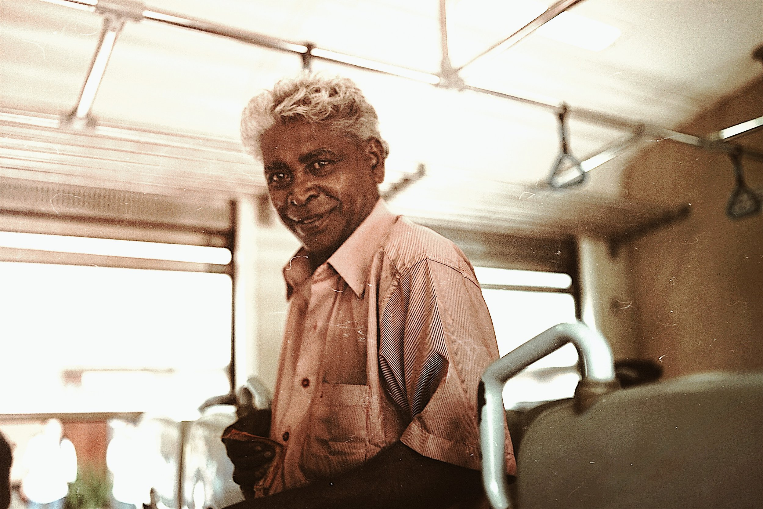 The Coastal Line - From Colombo Fort to Galle railway station it takes about 2-3 hours. The trains are usually packed and it's hard to find a seat. To make the trip bearable you can buy some refreshments, fruits and other fingerfood from gentlemen like this guy. He sold us some weird looking pastries.