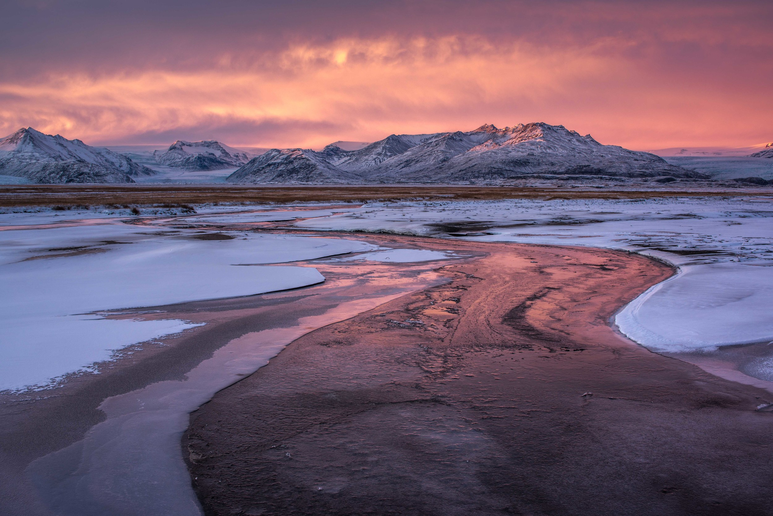Sunset during Winter in Iceland with River and Reflection
