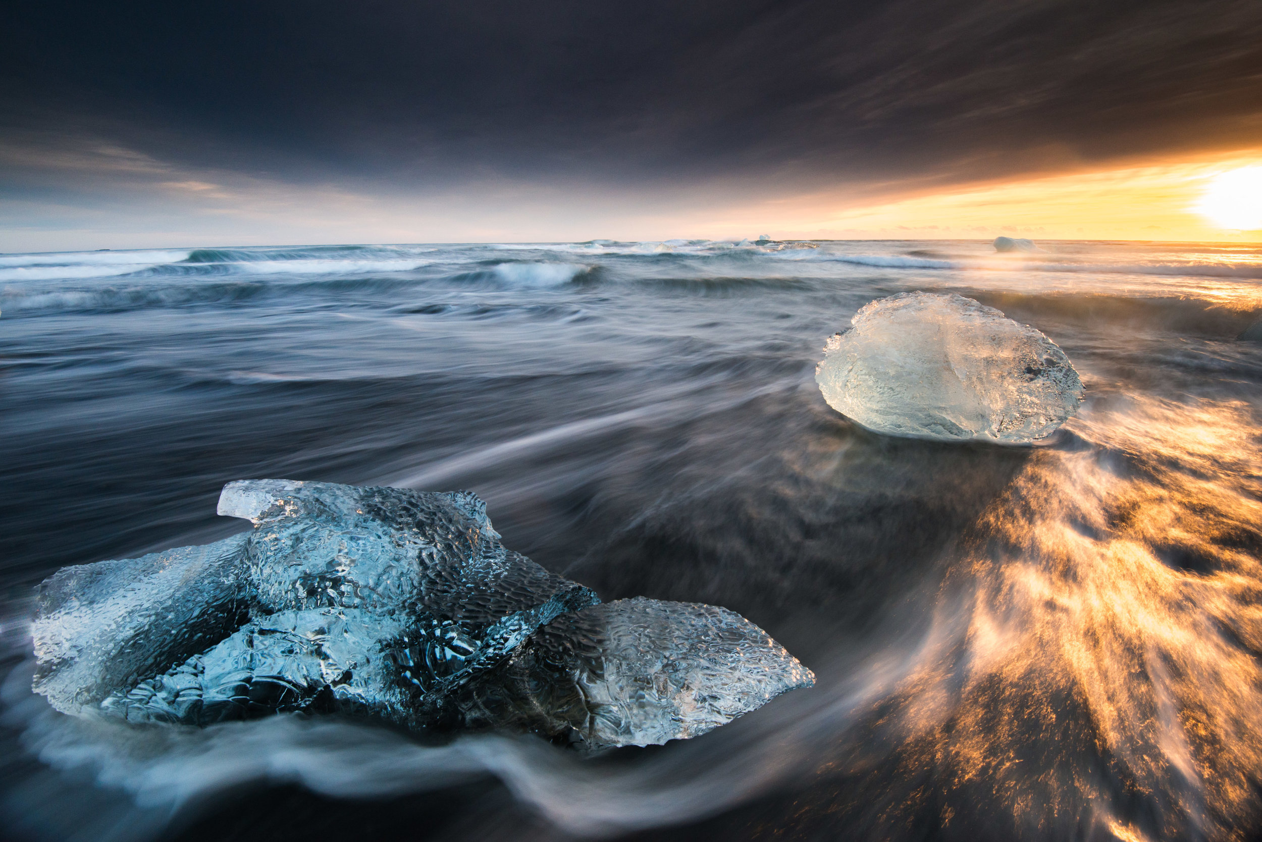 Black Sand Beach in Iceland with Ice and Sunlight
