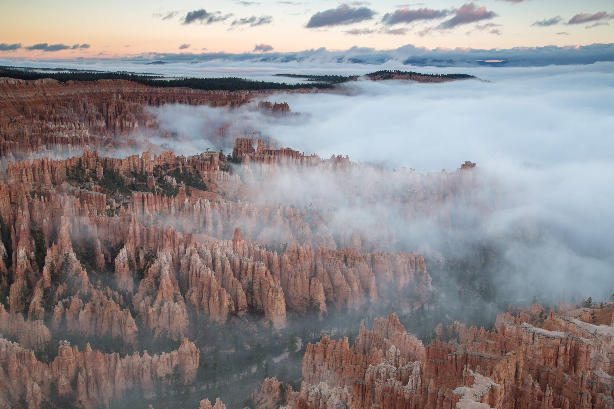 Bryce National Park with Low Fog and Clouds at Dawn