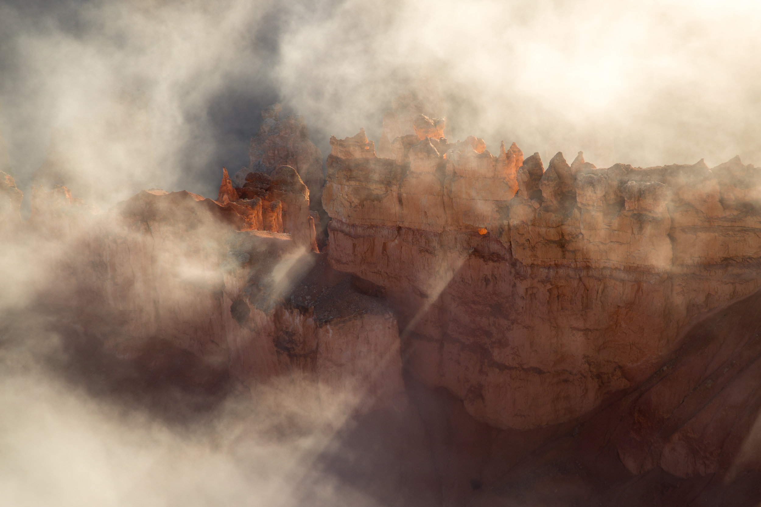 Bryce National Park with Reflected Light and Fog at Sunrise