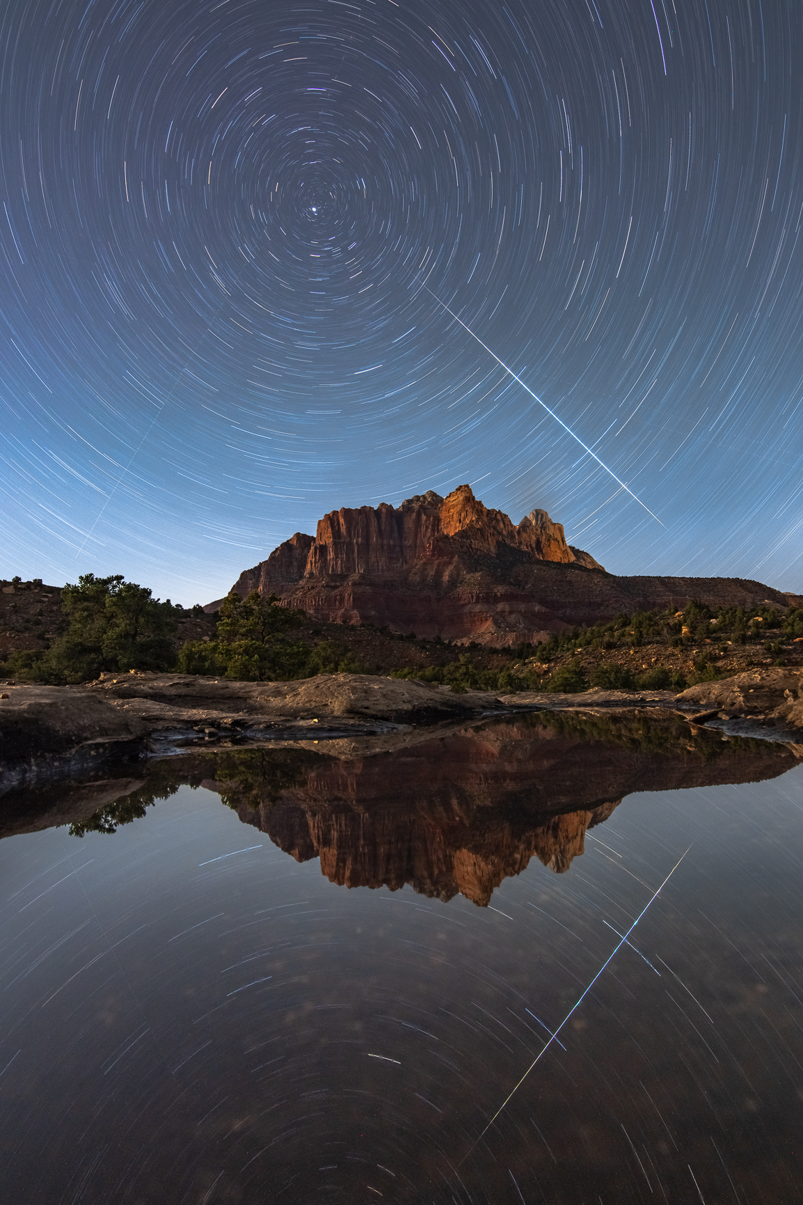 Zion at Night with Stars and Reflection Pool and Shooting Star