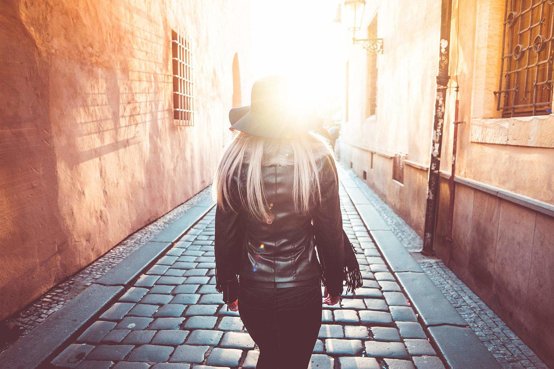 young-woman-walking-alone-in-prague-streets_free_stock_photos_picjumbo_DSC01149-2210x1474.jpg