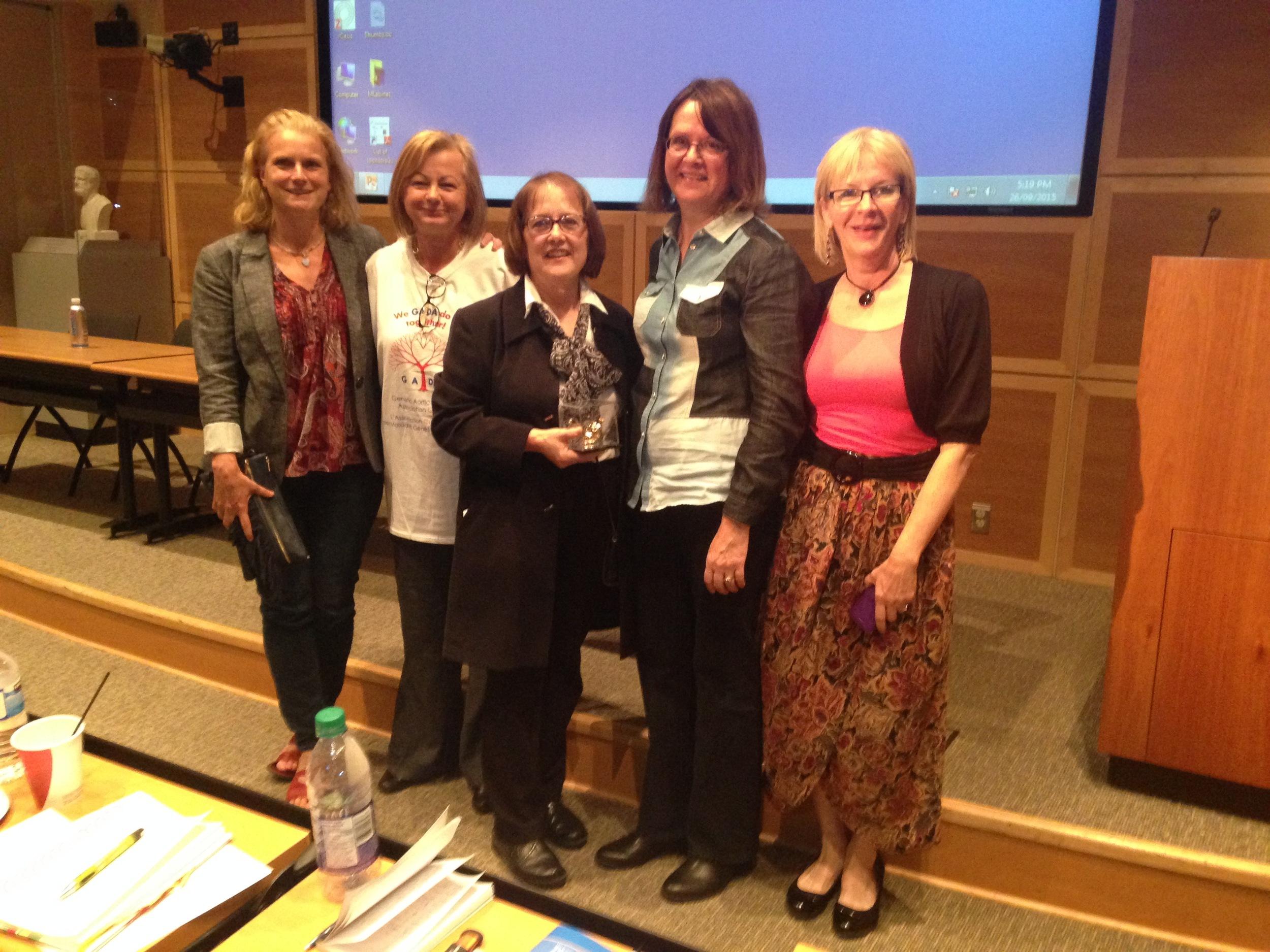 Suzanne Drouin (Center) - Awarded Elizabeth McHenry Volunteer Award by GADA Canada