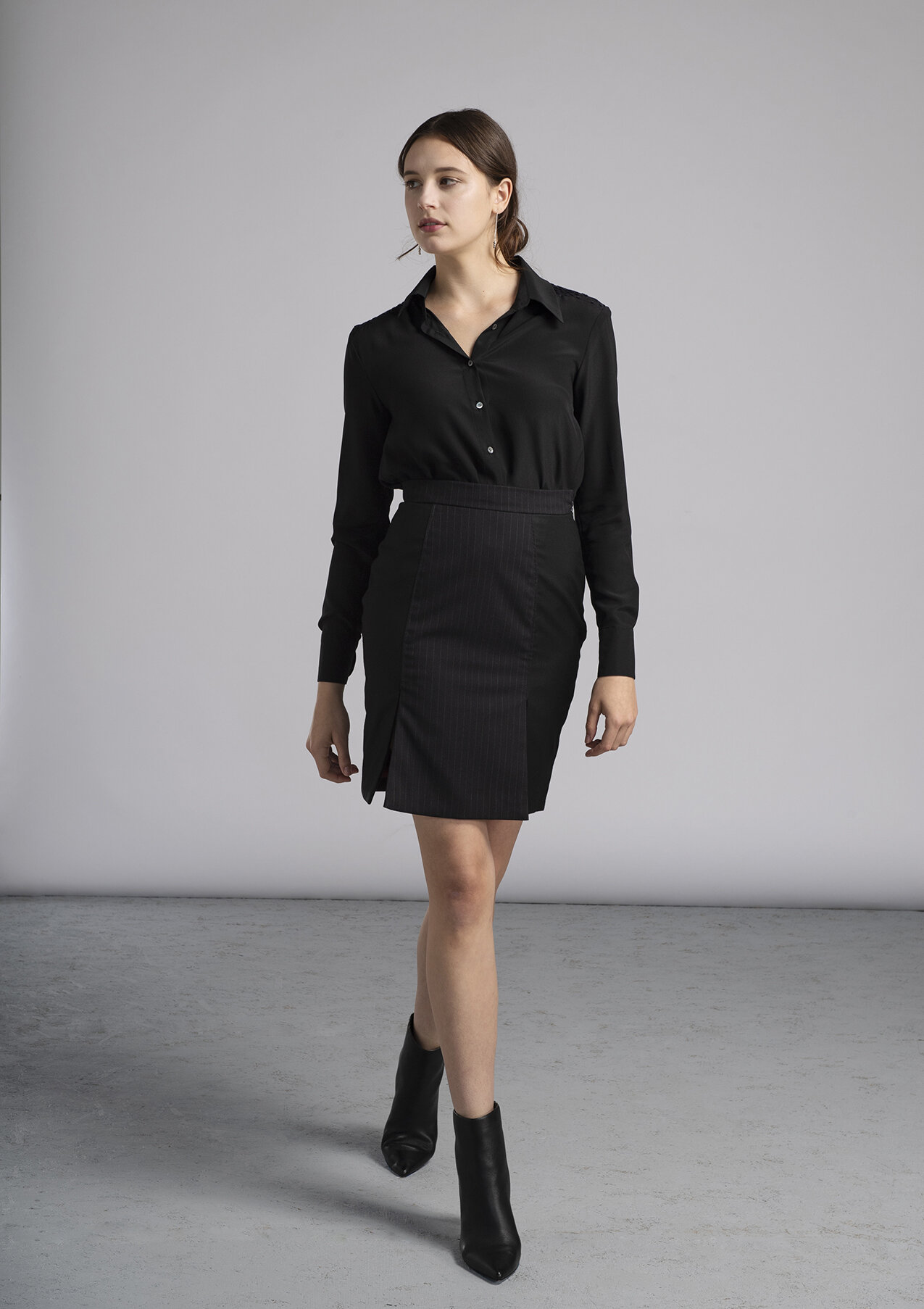 Women's made-to-measure black silk blouse and above the knee pencil skirt in black pinstripe
