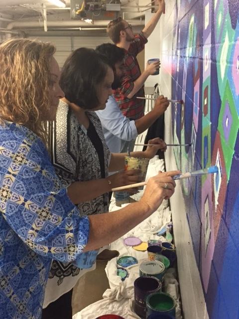 Shelter staff take a break to paint, Austin Street Shelter, Dallas, TX