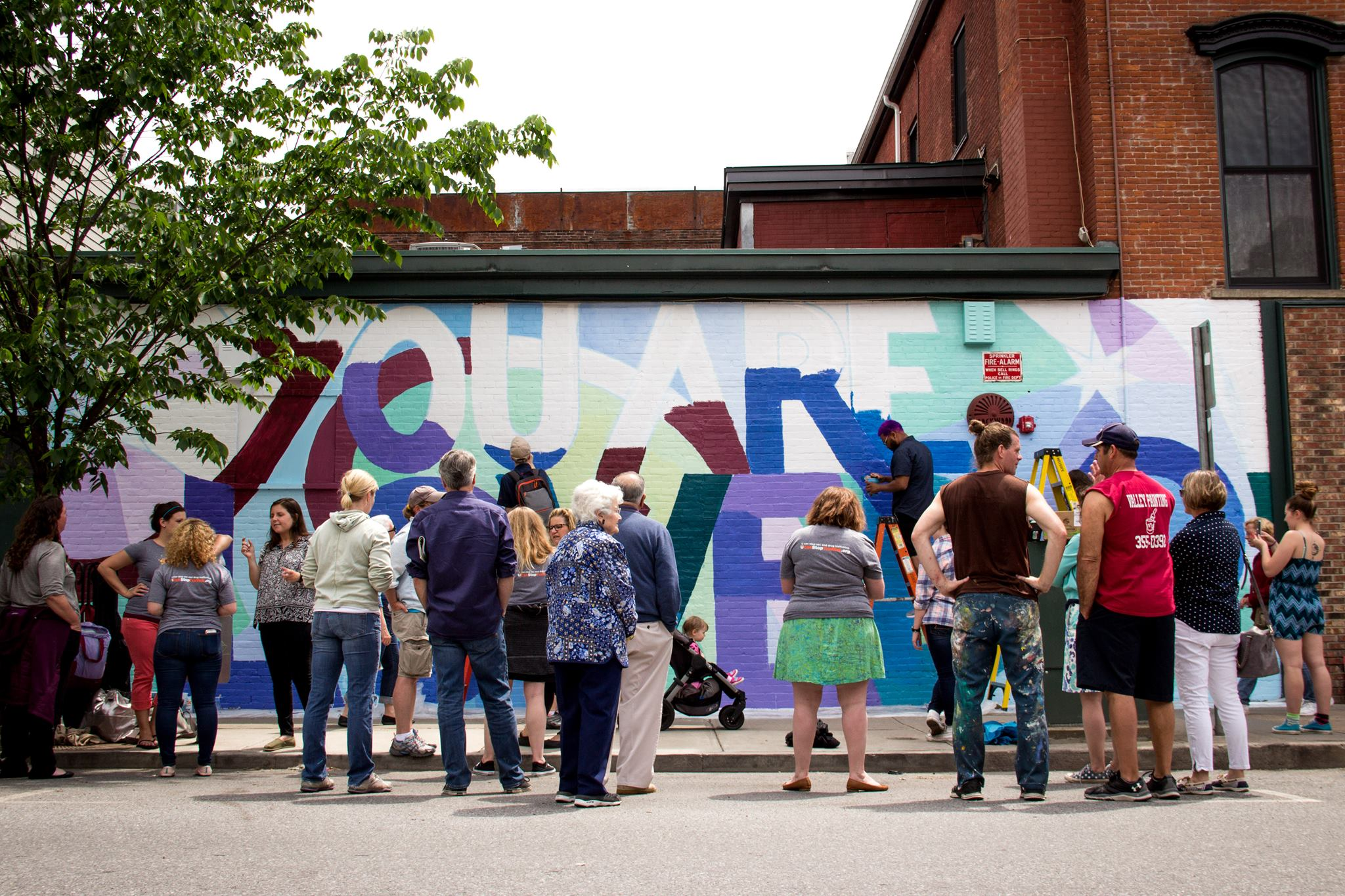Community members gather to paint in support of victims of human trafficking, Burlington, VT