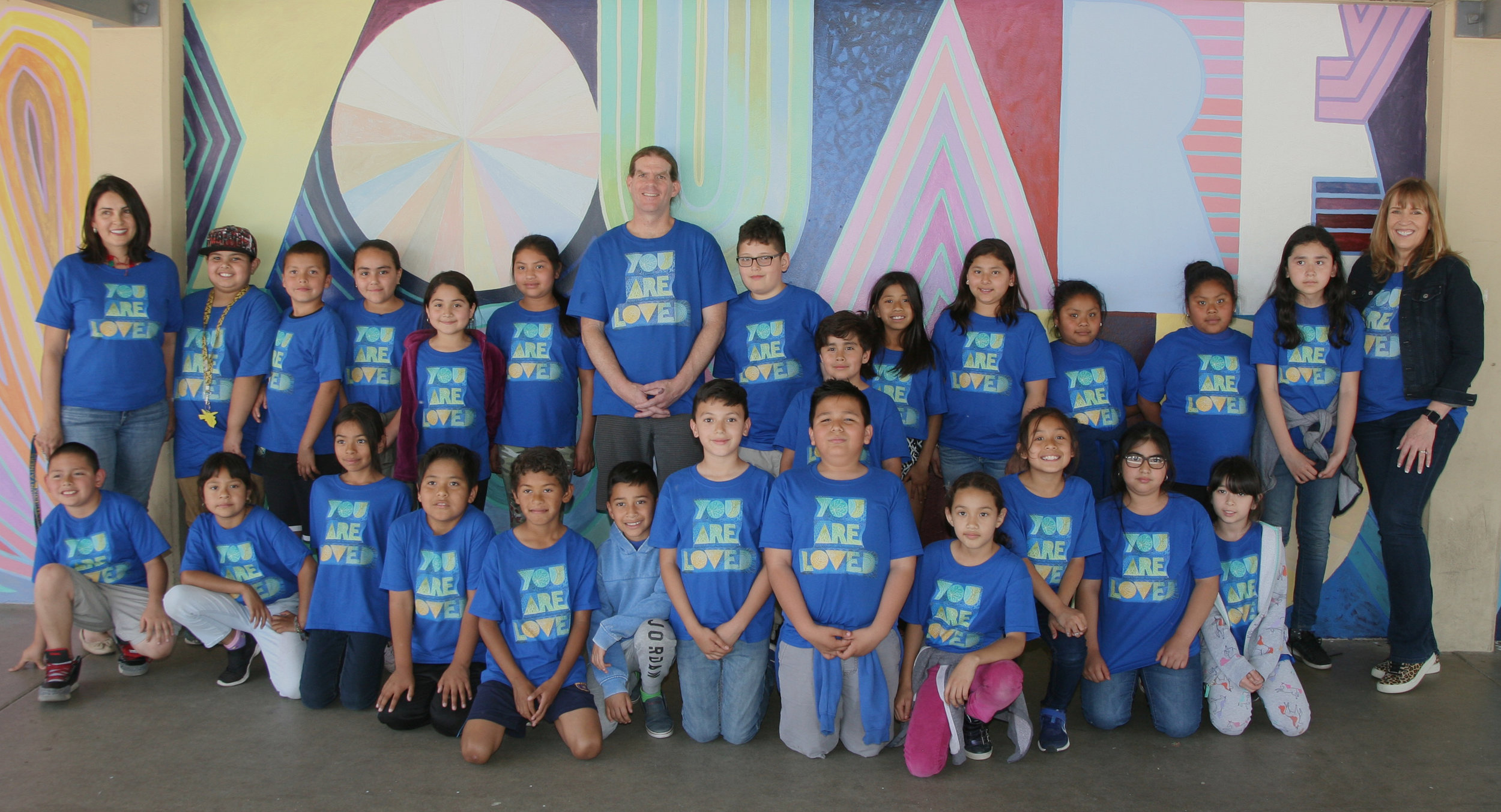 Students show off their brand new YOU ARE LOVED t-shirts, gifted by a local sponsor. Murray Elementary, Azusa, CA